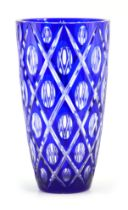A BOHEMIAN BLUE OVERLAY AND CLEAR TAPERING GLASS VASE with lozenge decoration to the body
