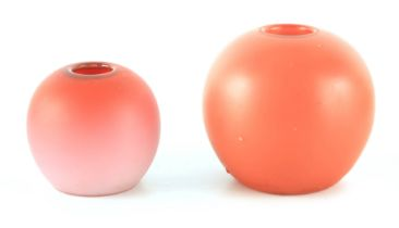 TWO GRADUATED BURMESE APRICOT AND SHADED GROUND GLOBULAR MATCH HOLDERS 10.5cm and 8cm high