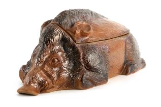 A LATE 19TH CENTURY EARTHENWARE SLIP GLAZED TUREEN modelled as a hog 44cm wide 20cm deep 18cm high