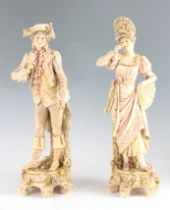 A PAIR OF LATE 19TH CENTURY ROYAL DUX FIGURES of a Lady and a Gentleman mounted on naturalistic