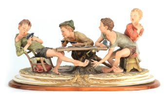"""A NAPLES CAPODIMONTE LARGE OVAL FIGURE GROUP """"The young card players"""" signed to base 56.5cm wide"""