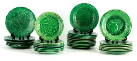 A LARGE COLLECTION OF 19TH CENTURY WEDGWOOD TYPE GREEN RELIEF MOULDED PLATES of varying size with