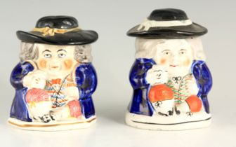 A PAIR OF COLOURFUL SEATED TOBY FIGURE LIDDED JARS 12.5cm high