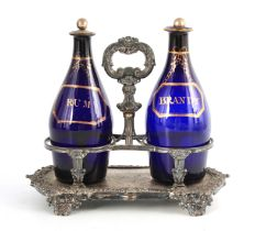 TWO EARLY 19TH CENTURY BRISTOL BLUE DECANTERS FOR RUM AND BRANDY mounted in an old Sheffield plate
