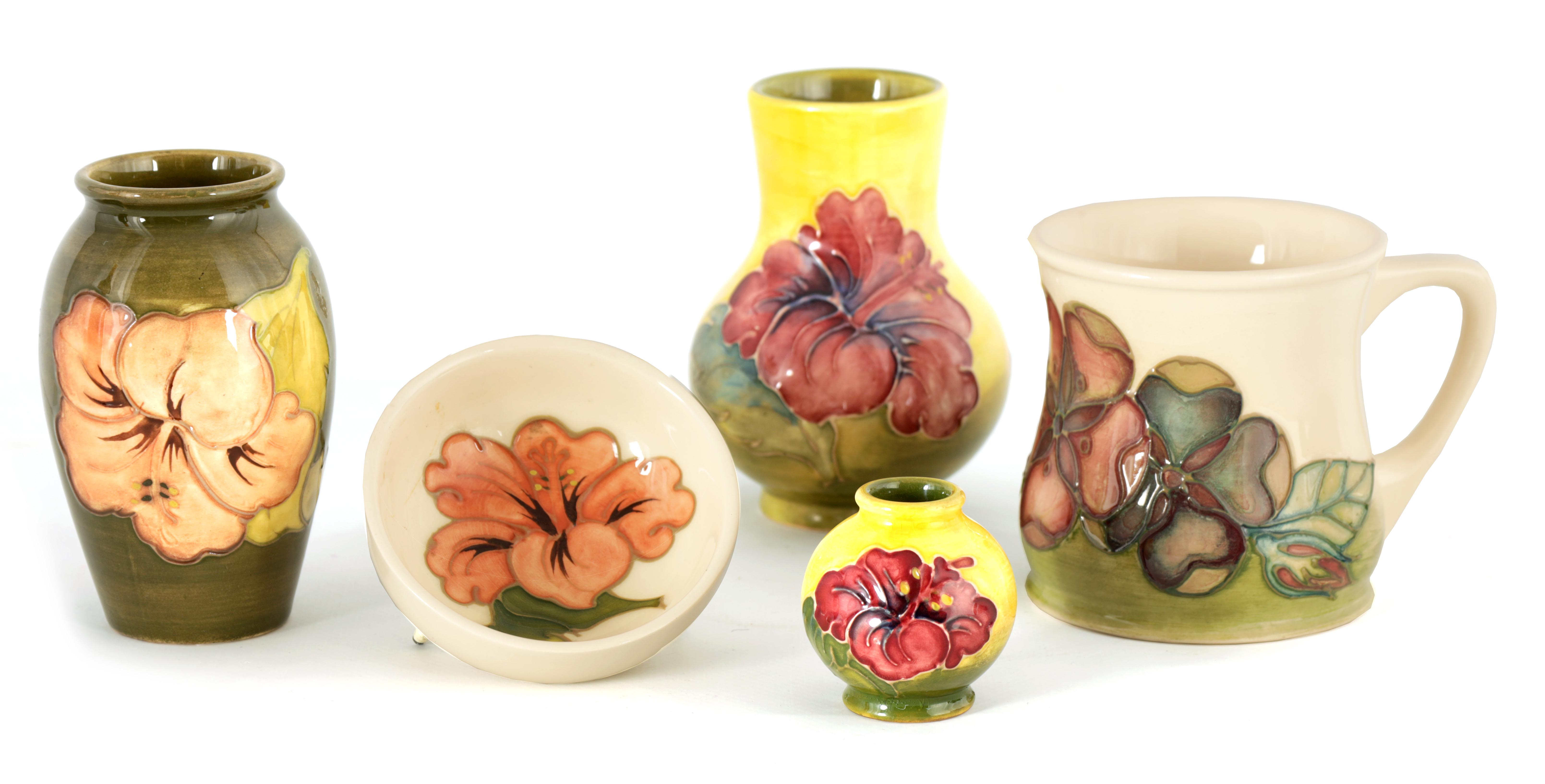 A MOORCROFT MINIATURE BULBOUS CABINET VASE tube lined and decorated with hibiscus flowerhead