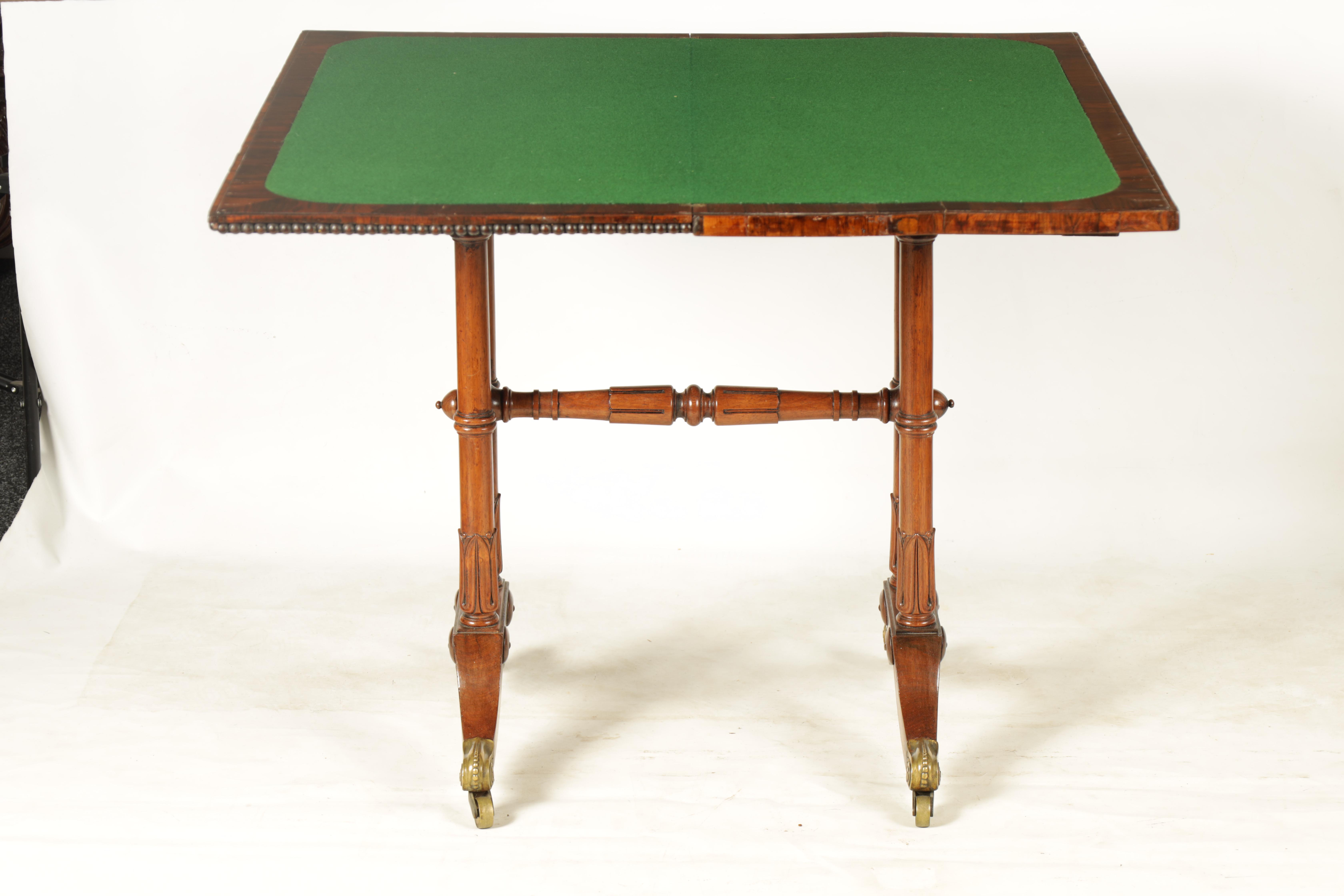 A REGENCY FIGURED ROSEWOOD CARD TABLE IN THE MANNER OF T & G SEDDON with revolving top revealing a - Image 6 of 9