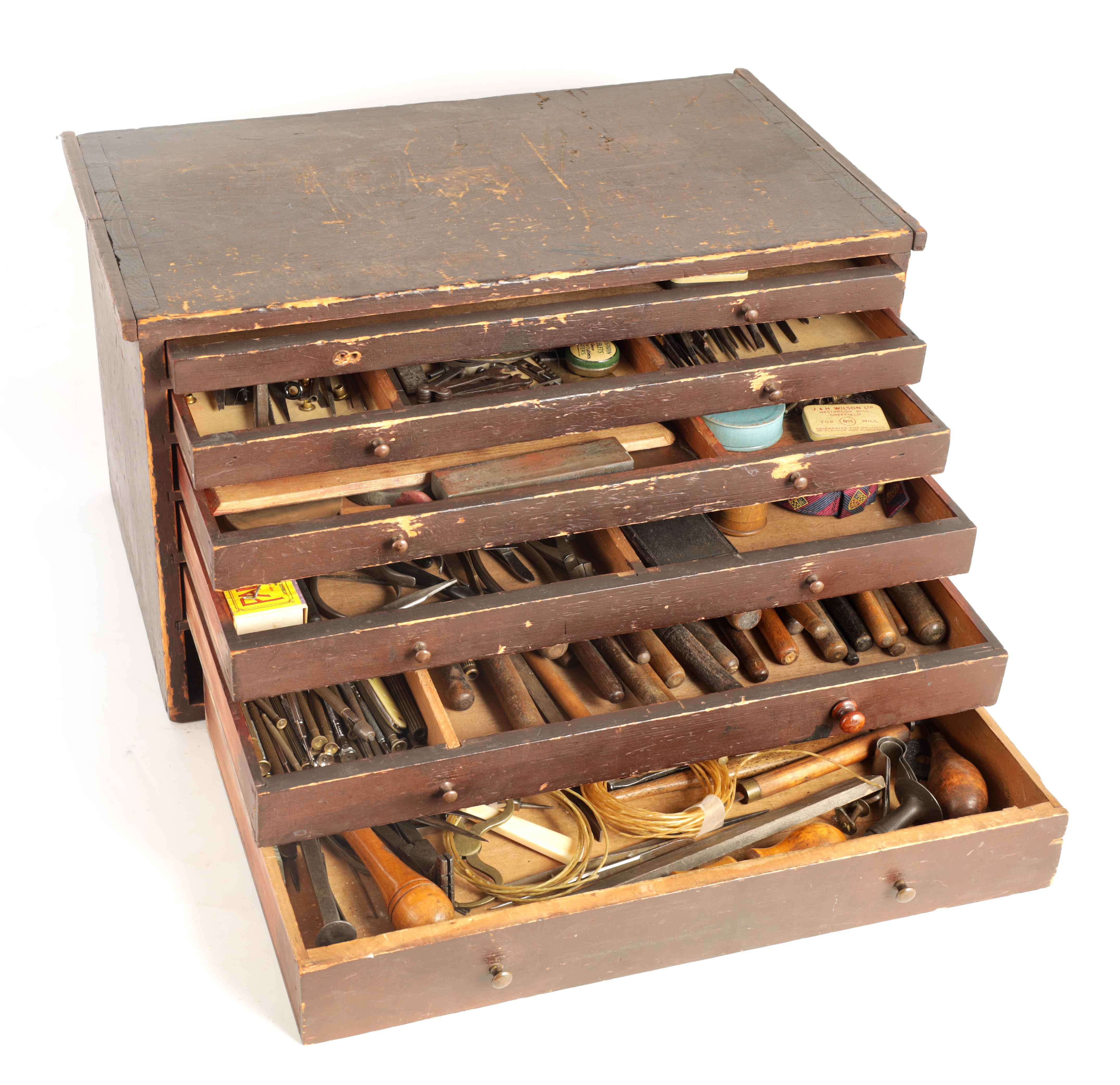 A LARGE COLLECTION OF JEWELERS AND WATCHMAKERS TOOLS contained in a set of pine drawers