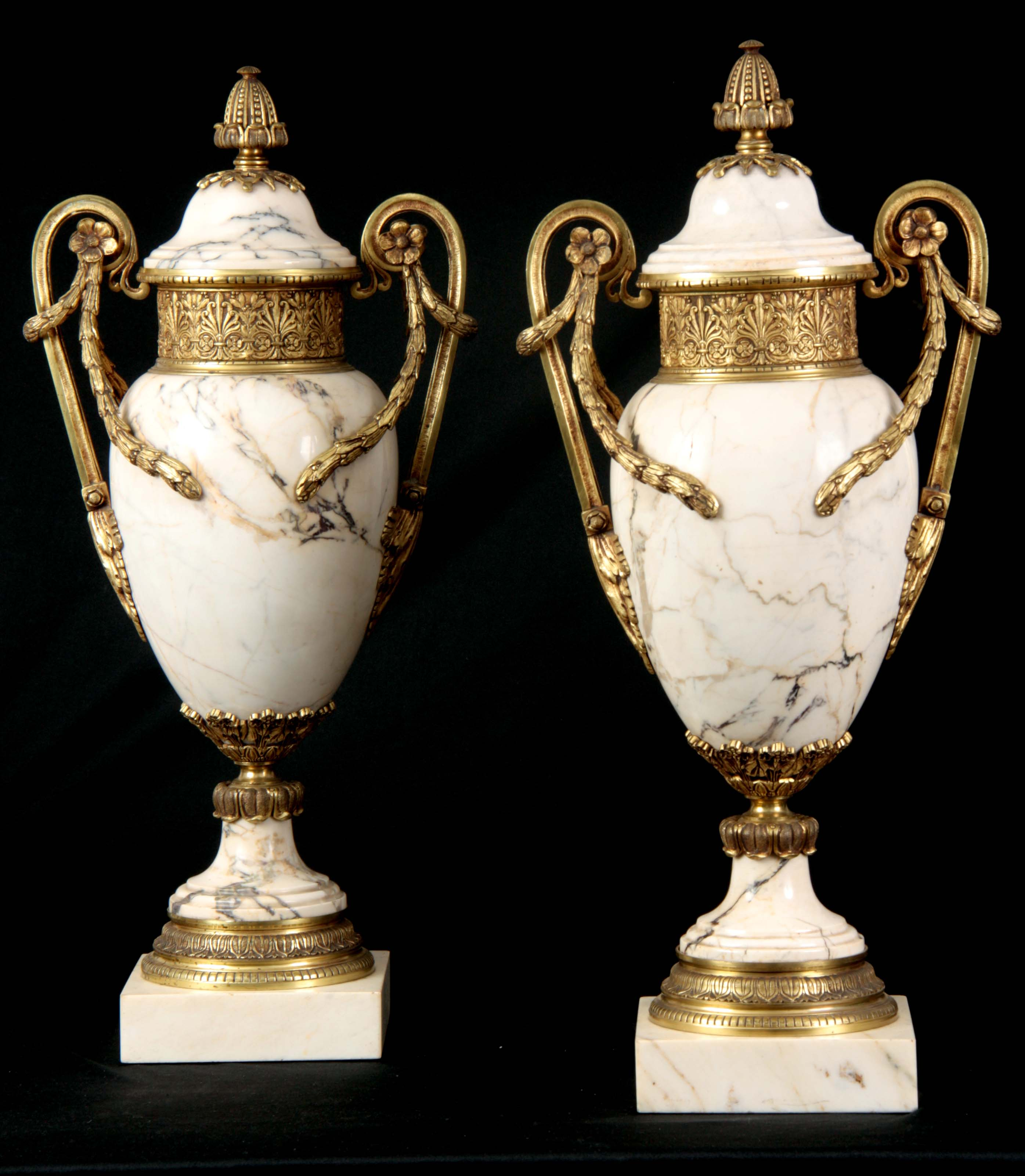 AN IMPRESSIVE PAIR OF FRENCH ORMOLU MOUNTED VEINED WHITE MARBLE CASOLETTES with floral swag work