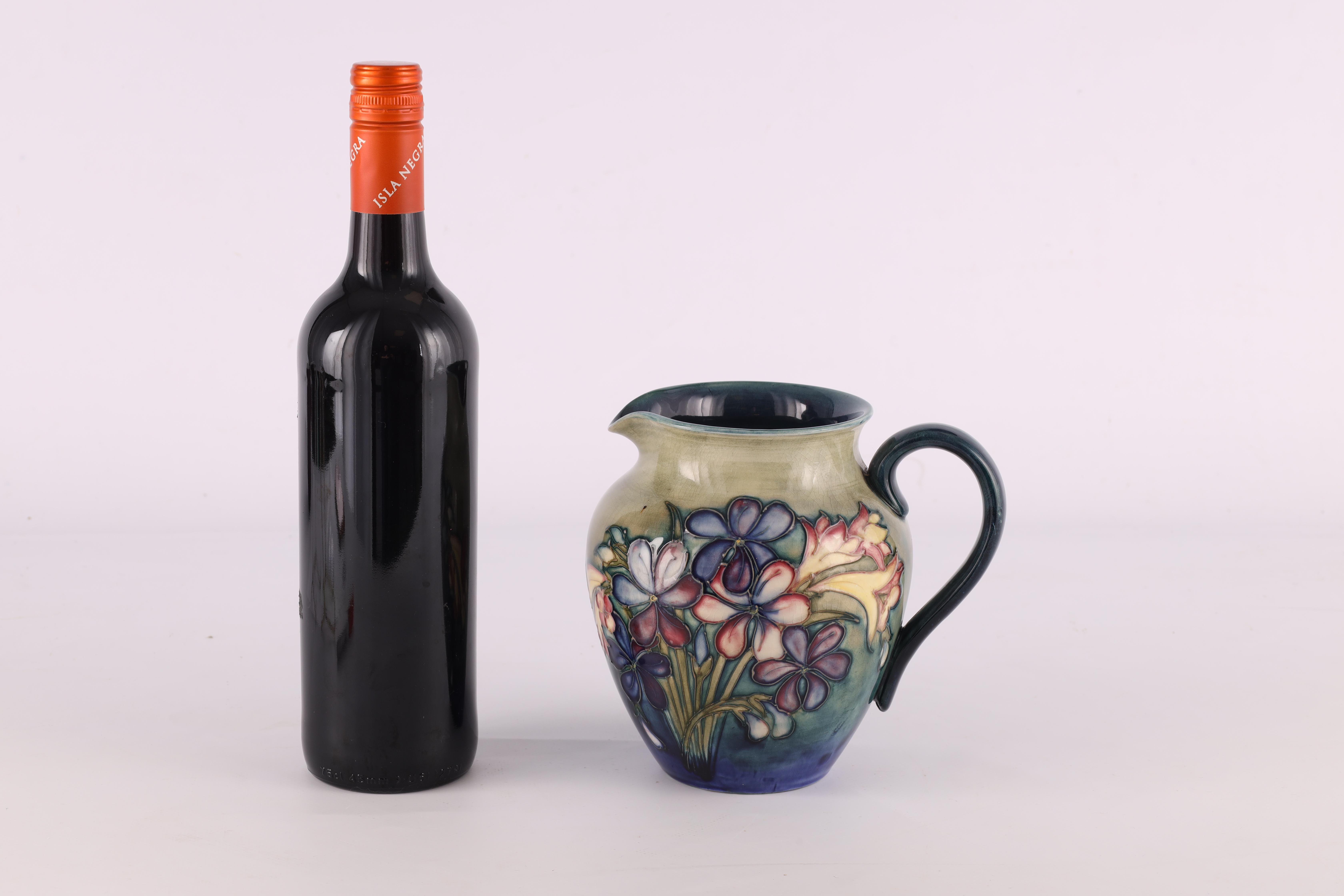 A MOORCROFT SHOULDERED TAPERING JUG tube lined and decorated in the spring flowers pattern on a - Image 2 of 6