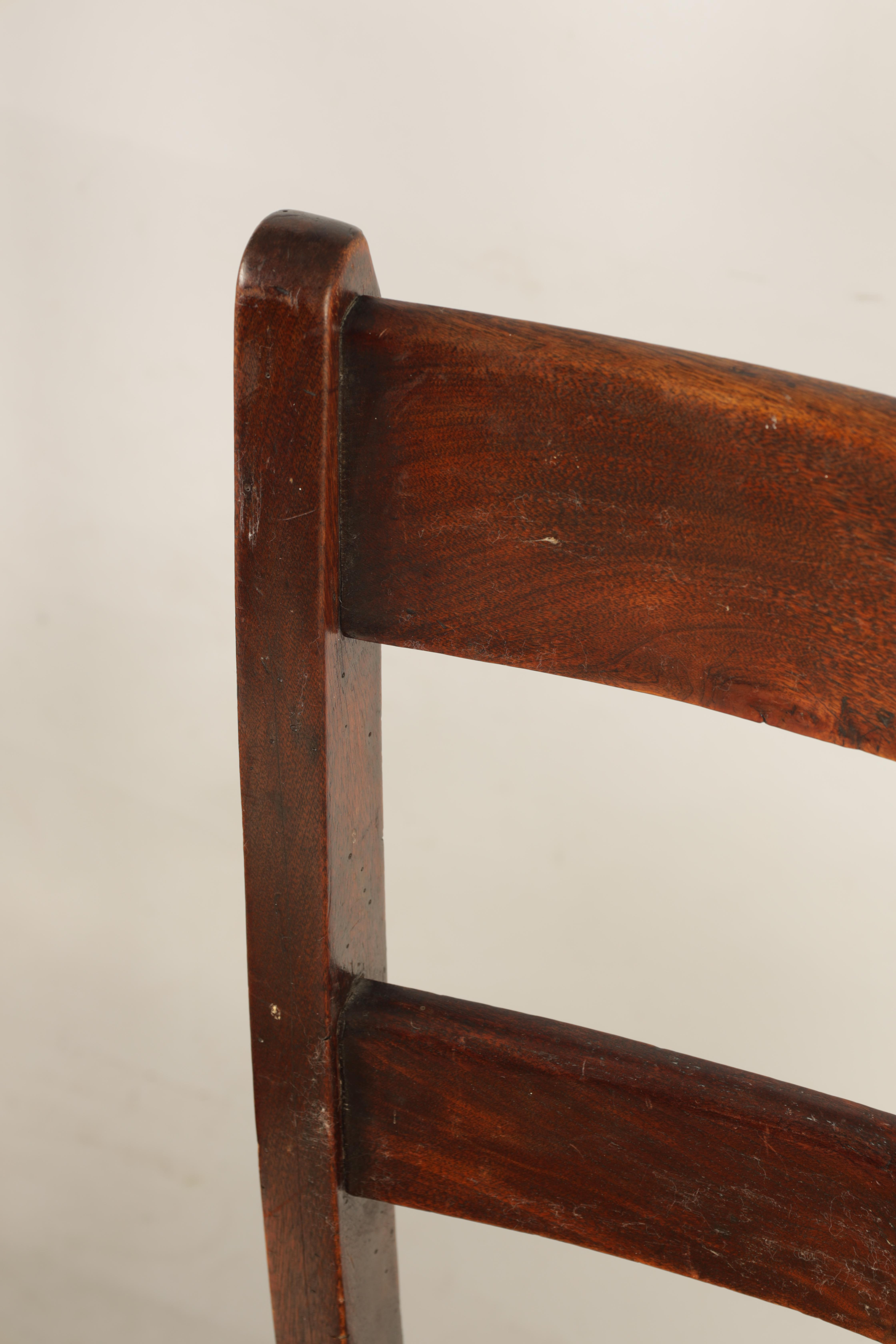 A SET OF SIX 19TH CENTURY COUNTRY FRUITWOOD DINING CHAIRS with rush seats and bar backs; standing on - Image 9 of 9