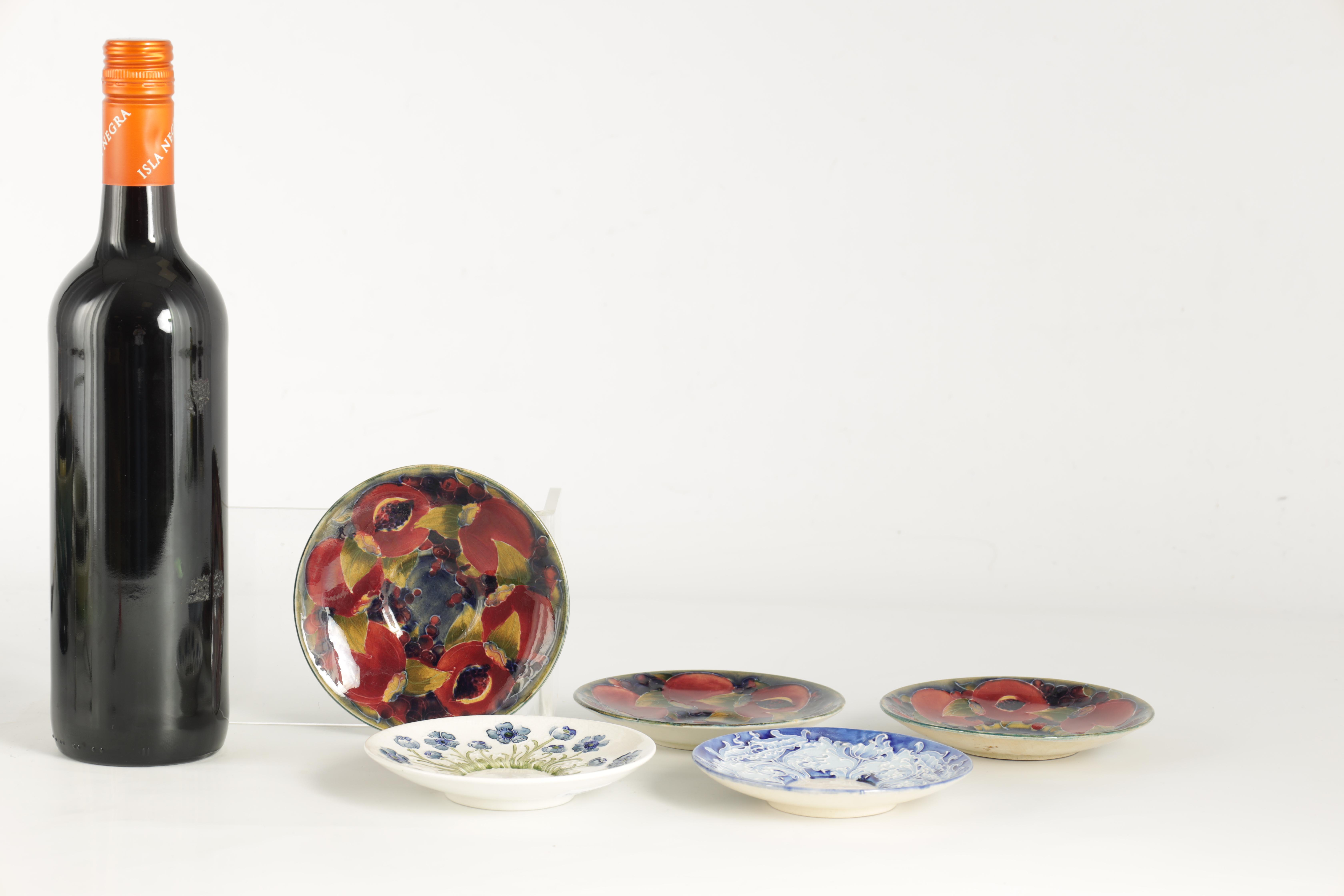 A COLLECTION OF FIVE MOORCROFT SAUCERS including three early monogrammed Pomegranate examples, a - Image 2 of 3