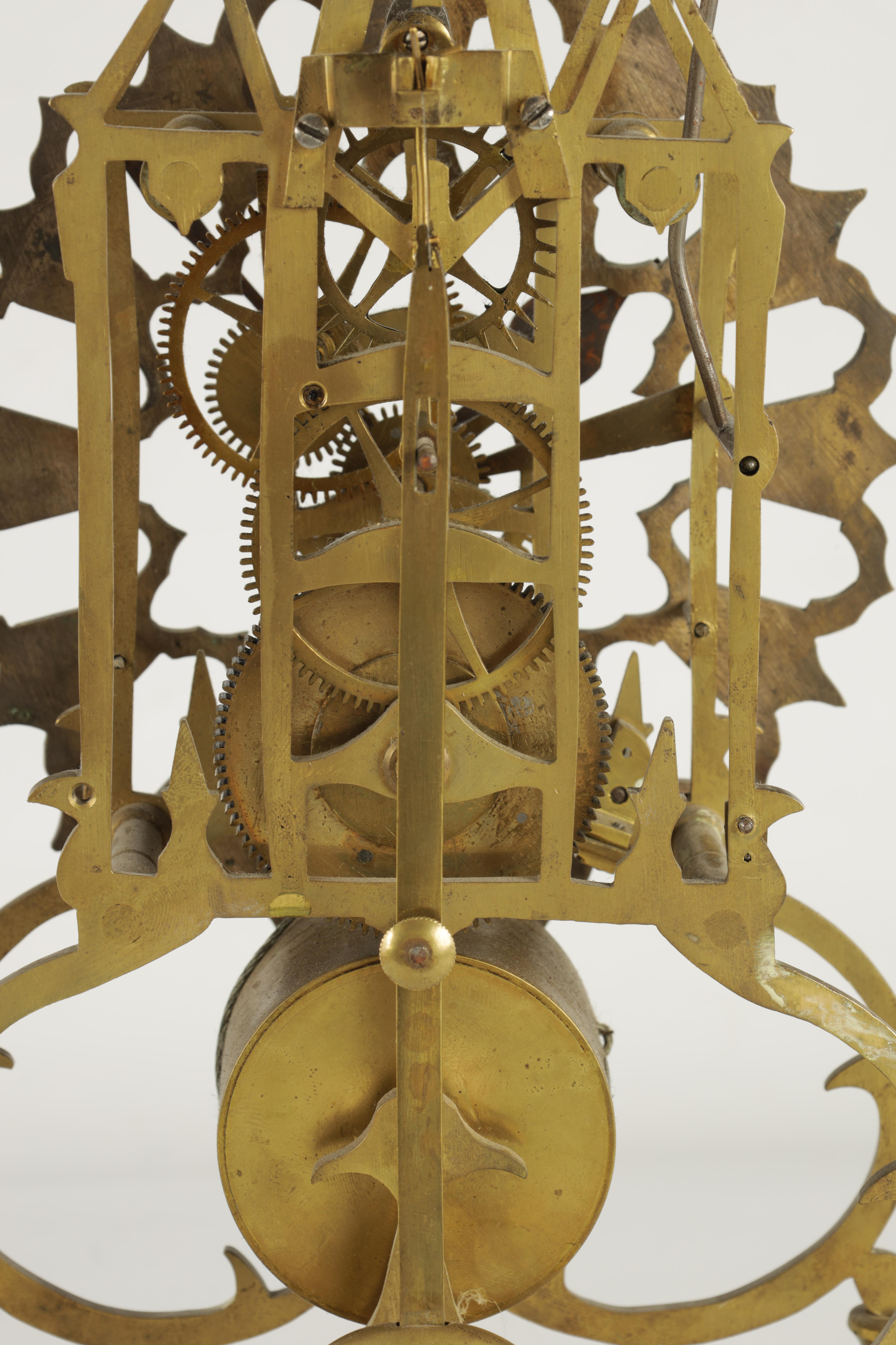 A 19TH CENTURY BRASS SINGLE FUSEE 8-DAY SKELETON CLOCK with liar shaped frame joined by four - Image 7 of 7