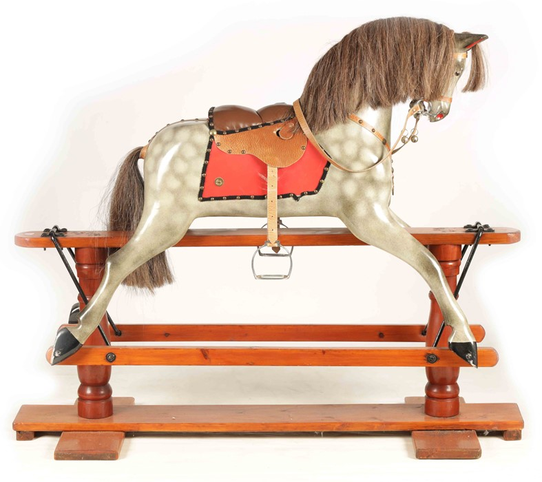 A 20TH CENTURY DAPPLE GREY PAINTED WOODEN ROCKING HORSE with leather seat and bridle 138cm wide - Image 2 of 8