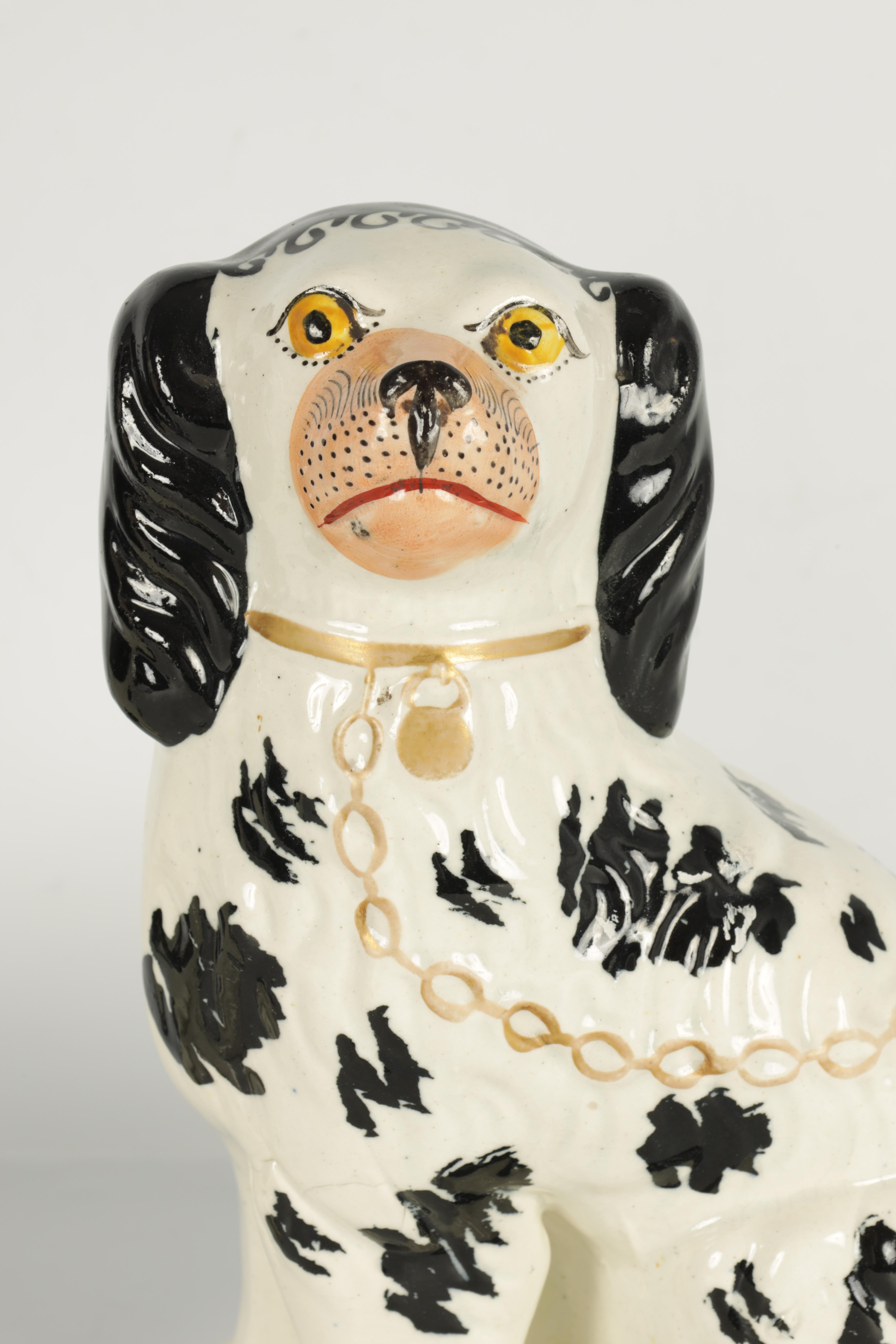A PAIR OF 19TH CENTURY STAFFORDSHIRE 'DISRAELI CURL' SPANIELS 23cm high - Image 3 of 11