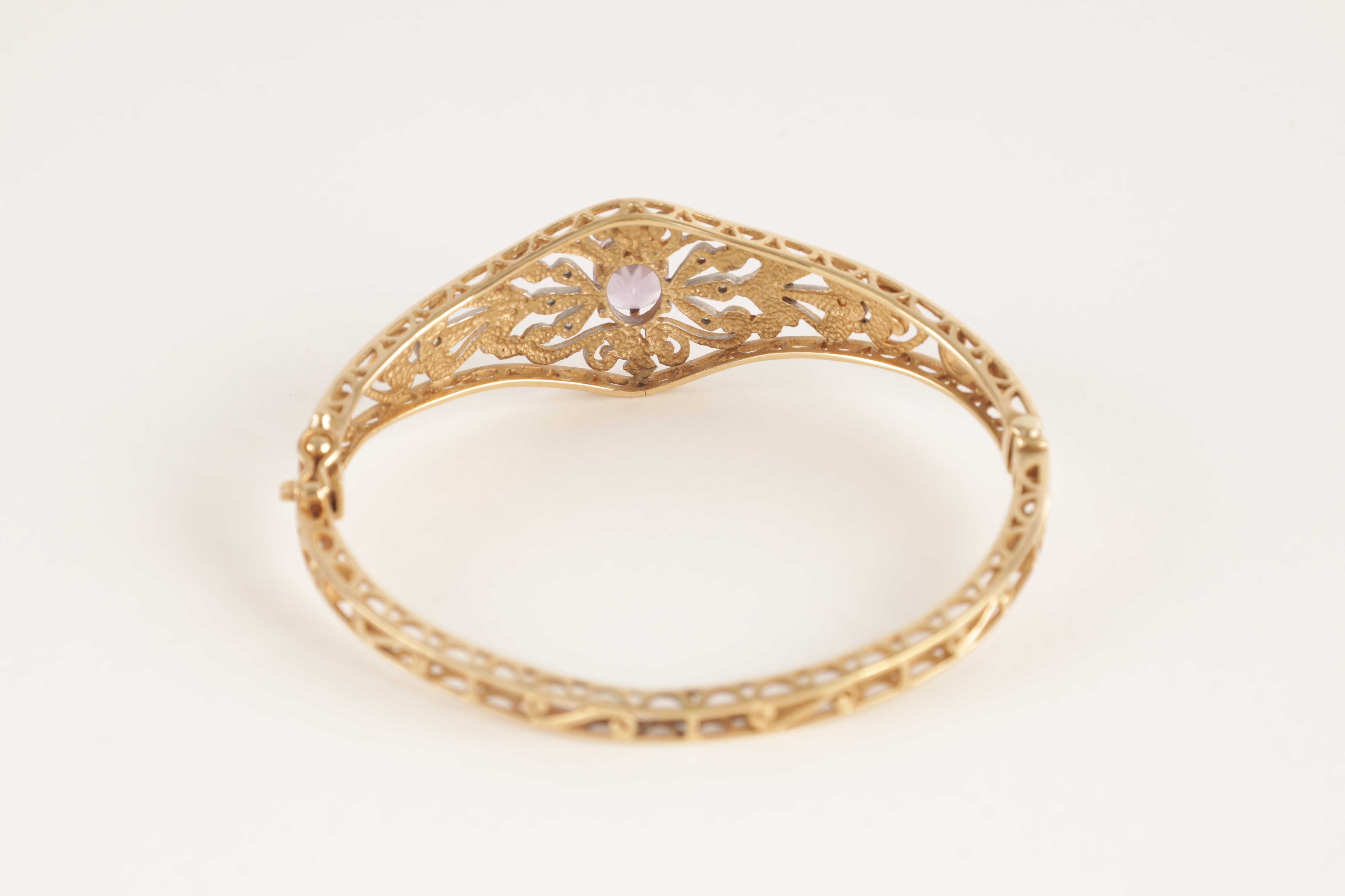 A LADIES 9CT GOLD DIAMOND AND AMETHYST BANGLE having filigree scrollwork decoration with diamonds - Image 2 of 4