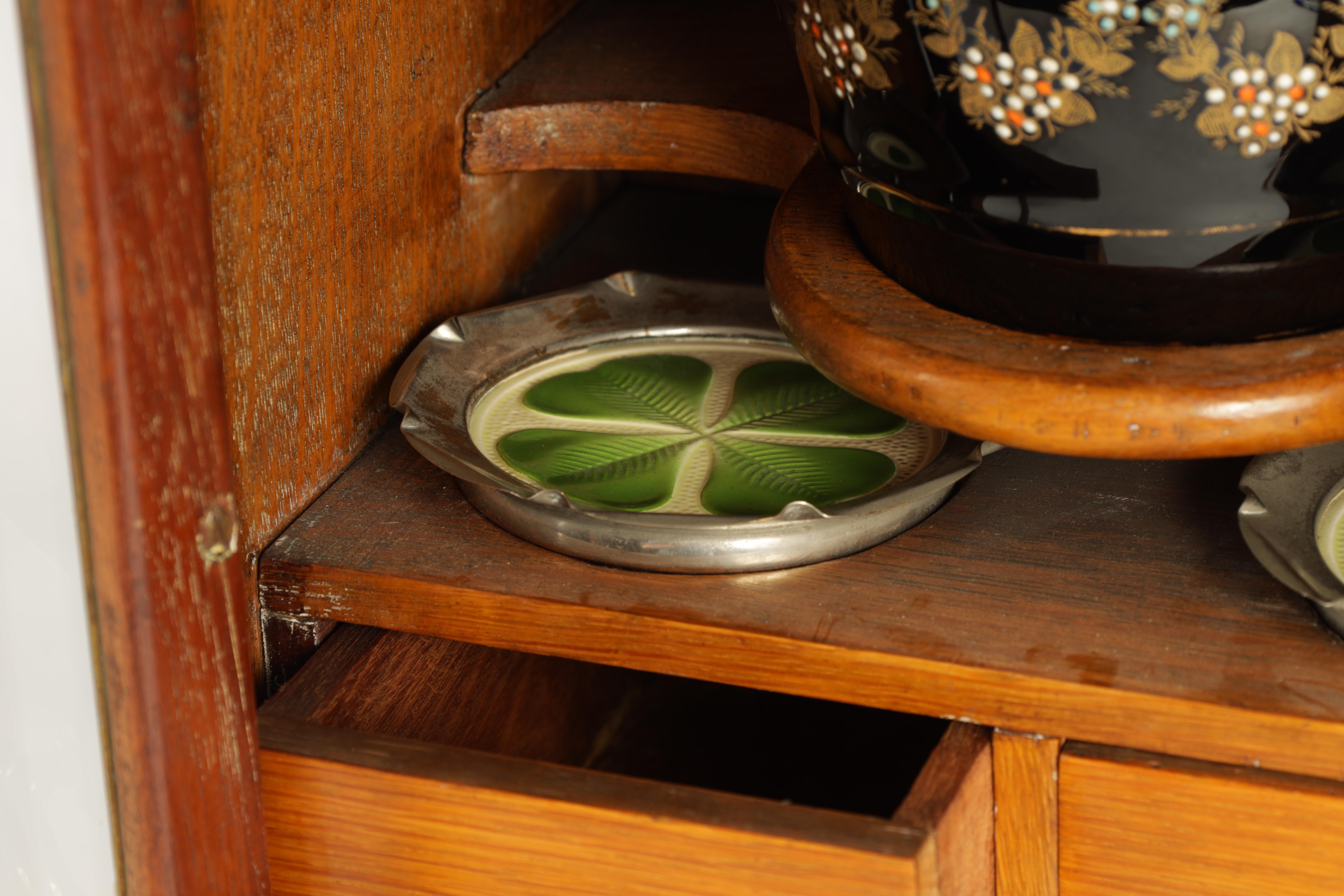 A STYLISH EDWARDIAN OAK SMOKERS CABINET with glazed door enclosing a shelved three drawer interior - Image 5 of 11