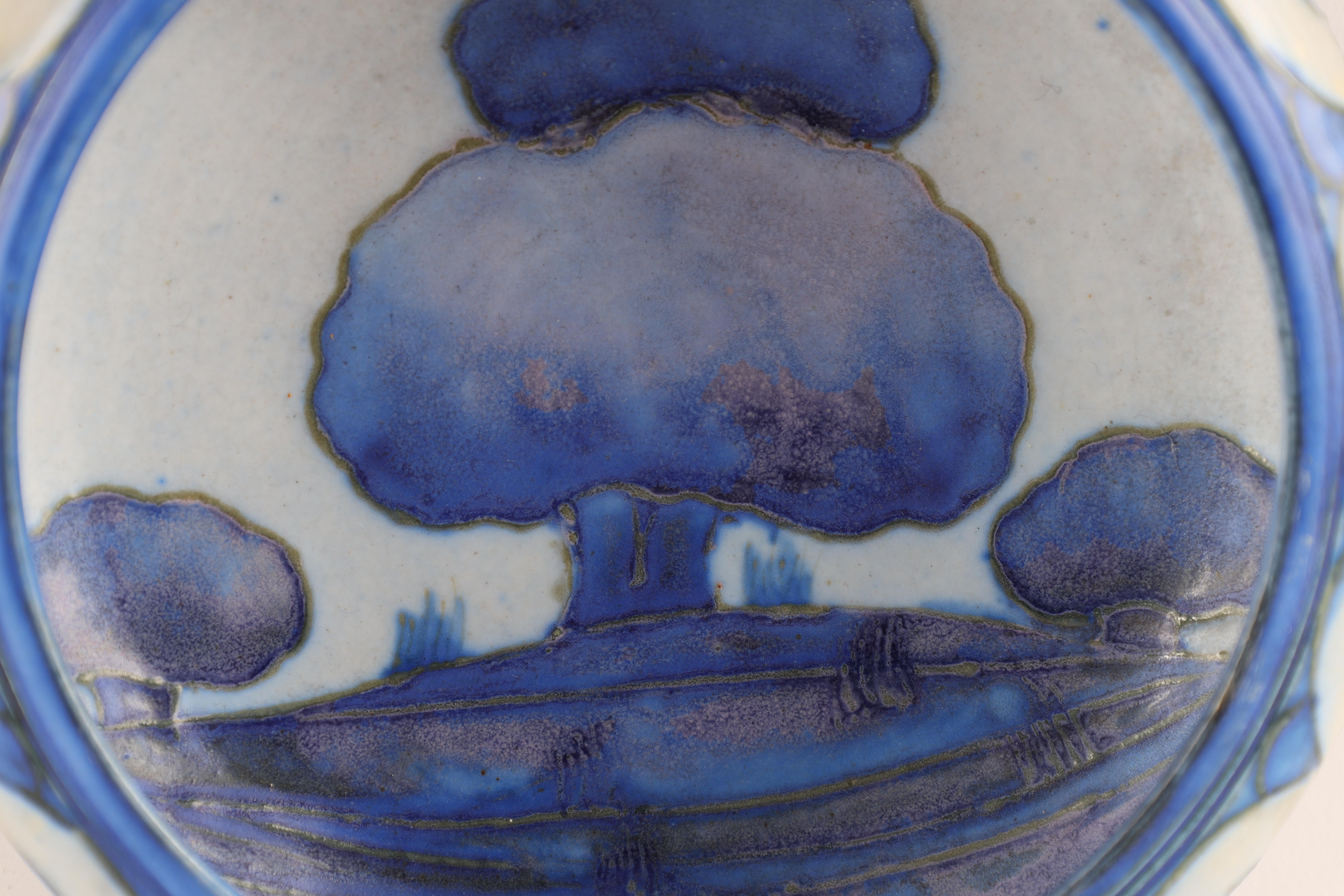 A MOORCROFT SMALL SHALLOW DISH WITH CURVED RIM decorated in the blue ground Dawn Landscape pattern - Image 2 of 5