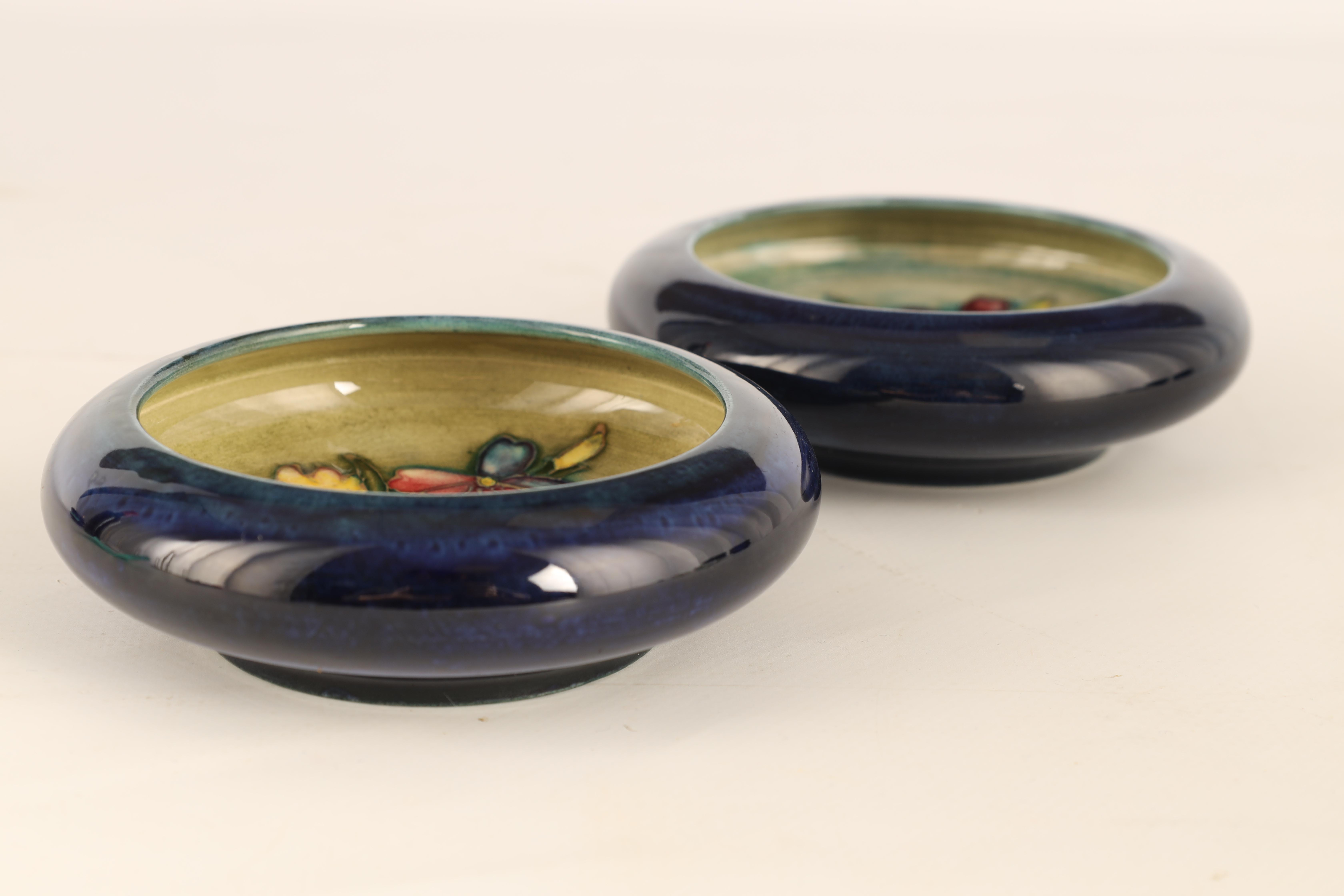 TWO MOORCROFT SHALLOW SMALL DISHES WITH CURVED RIMS decorated with sprays of spring flowers on a - Image 3 of 5
