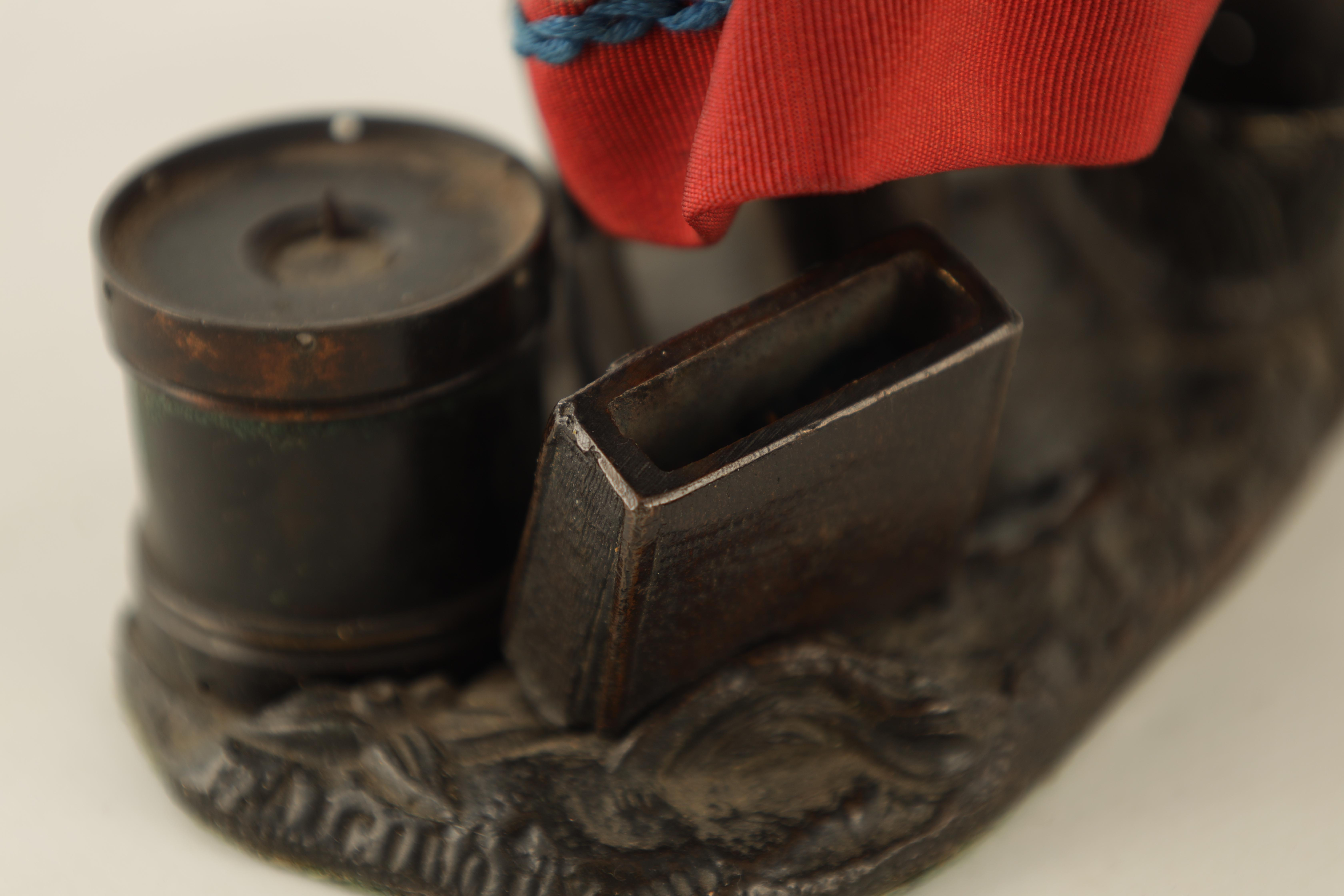 A LATE 19TH CENTURY NOVELTY BRONZE DESK COMPENDIUM DEPICTING A LADY HOLDING A RIFFLE with red - Image 7 of 10