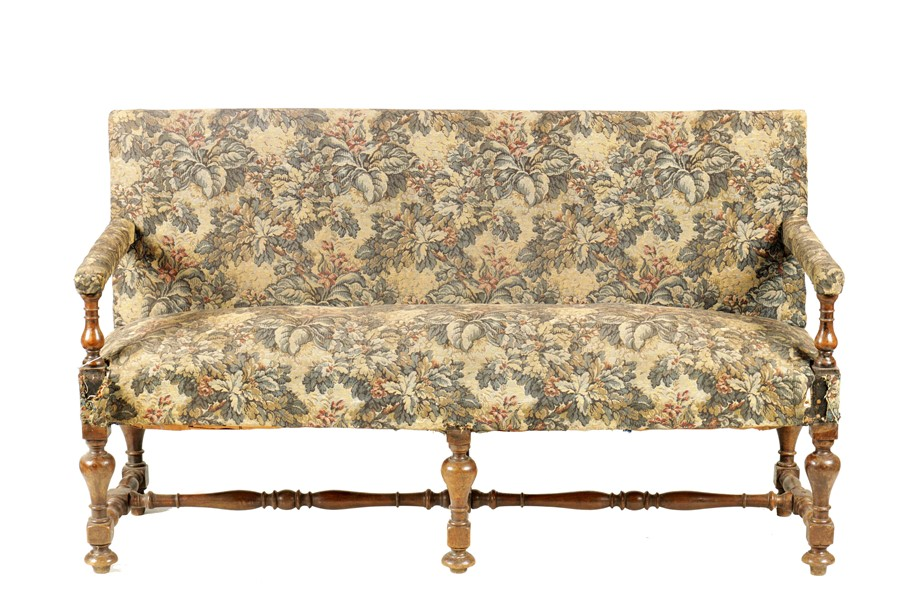 A SMALL LATE 17TH CENTURY TURNED WALNUT TWO SEATER SETTEE with tapestry upholstery, raised on a ring