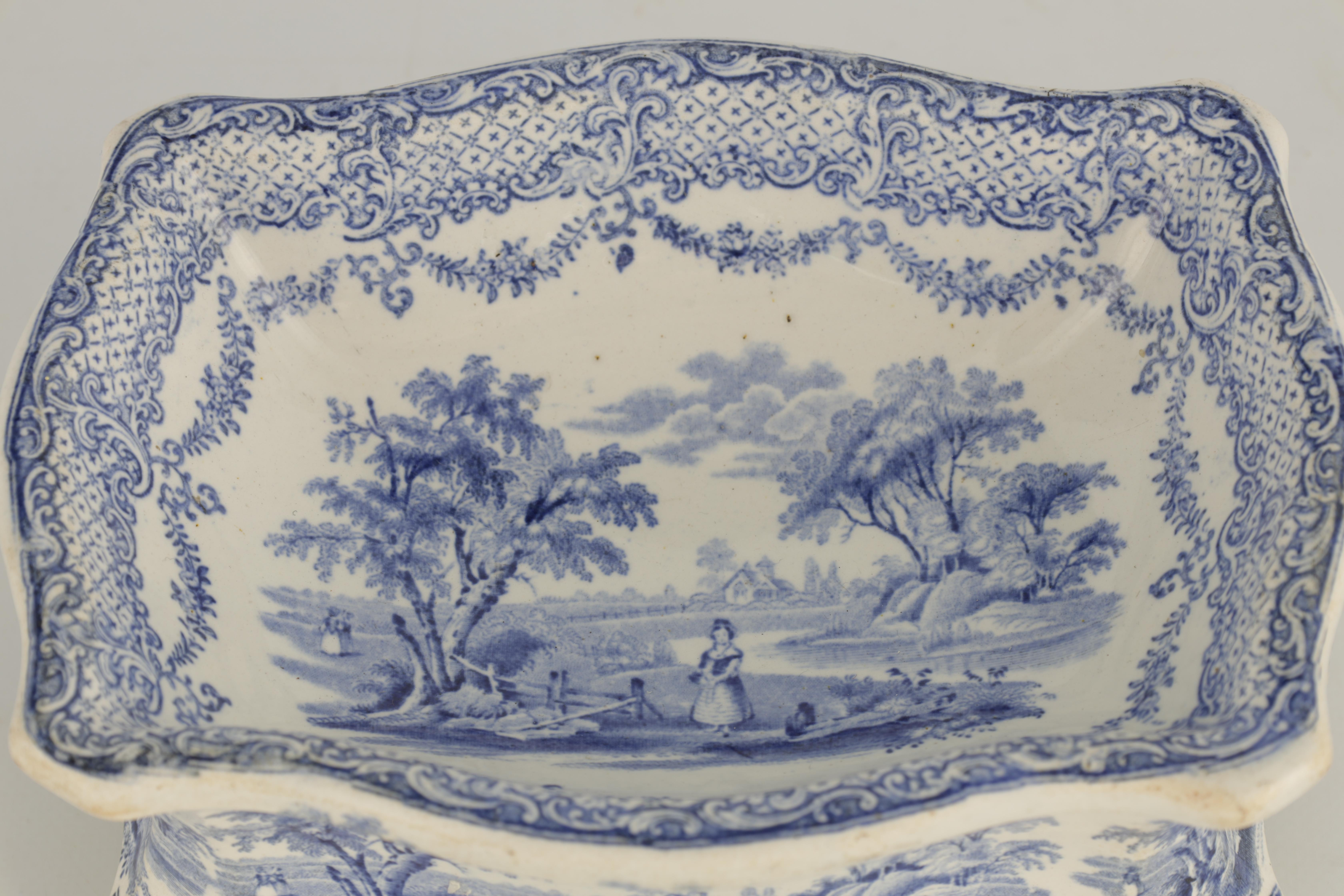 A RARE 19TH CENTURY RIDGWAY BLUE AND WHITE POTTERY DOG BOWL decorated with landscape scenes - Image 4 of 7