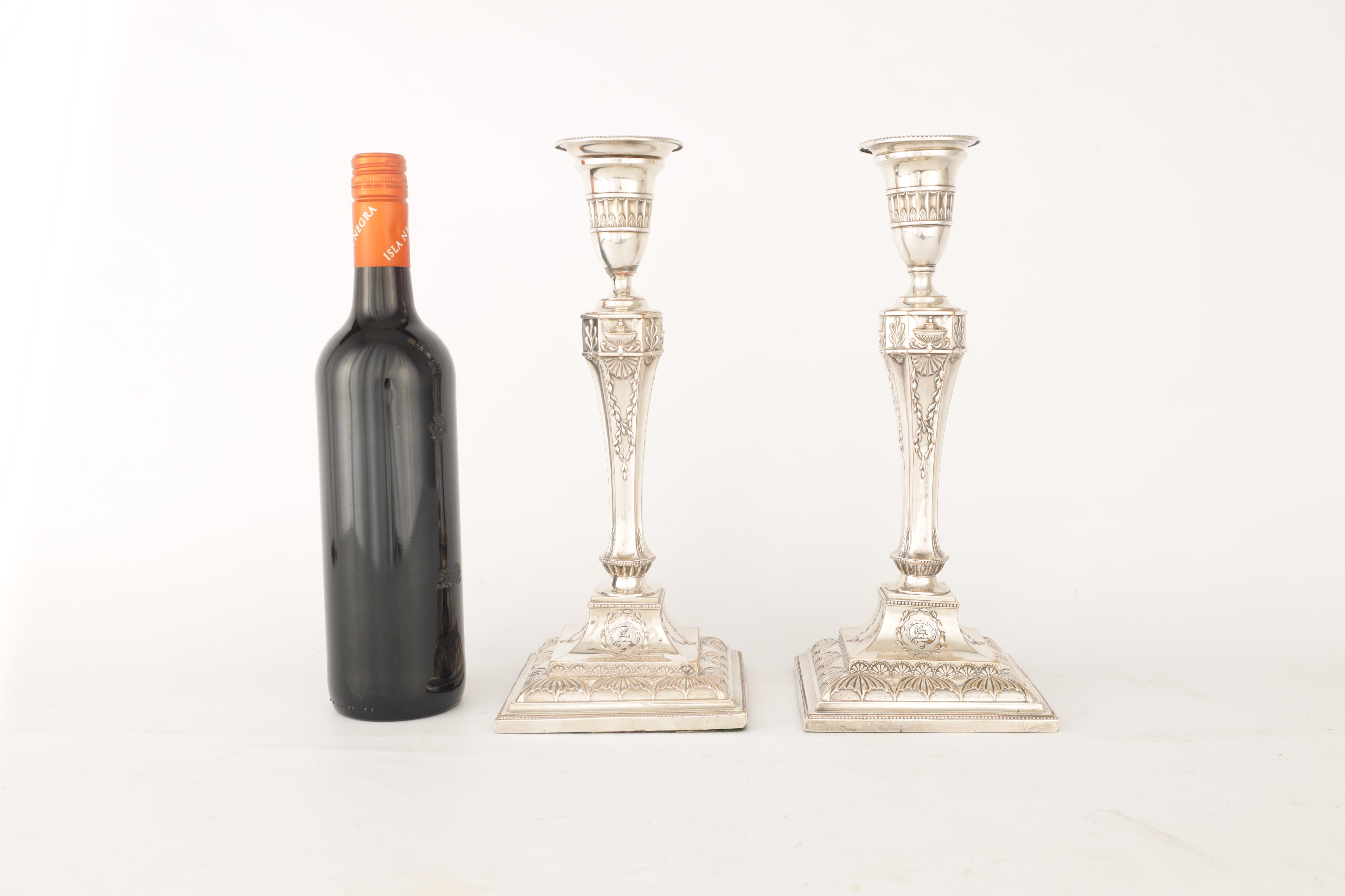 A PAIR OF 19TH CENTURY SHEFFIELD PLATE SILVER ON COPPER ADAM STYLE CANDLESTICKS bearing the crest - Image 5 of 5