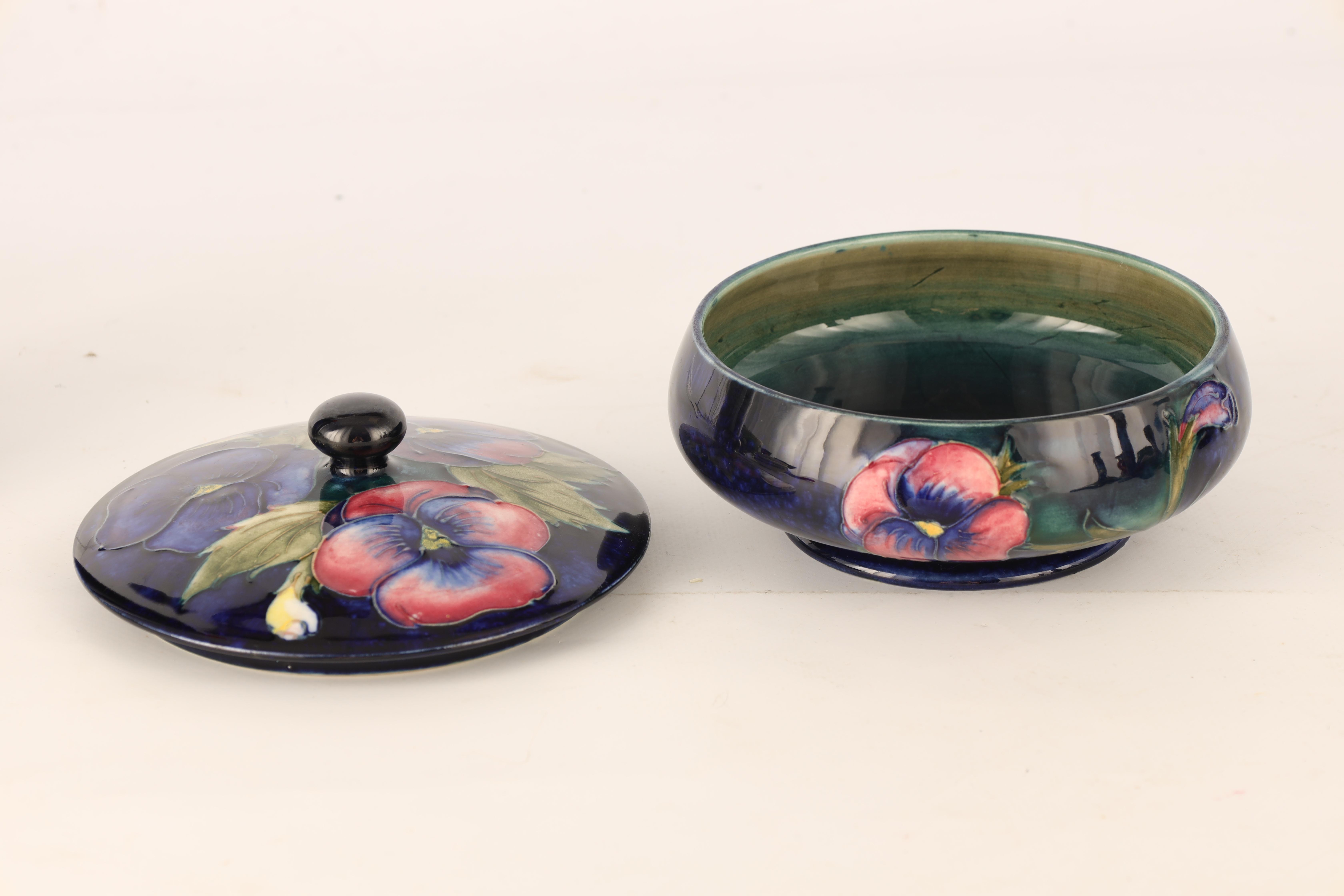 A MOORCROFT SHALLOW FOOTED BOWL AND COVER tube lined and decorated with leafing Pansy sprays on a - Image 3 of 6