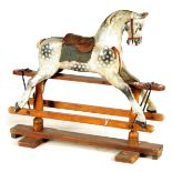 A 19TH CENTURY CARVED WOOD DAPPLED GREY PAINTED ROCKING HORSE BY AYRES LONDON bearing makers label