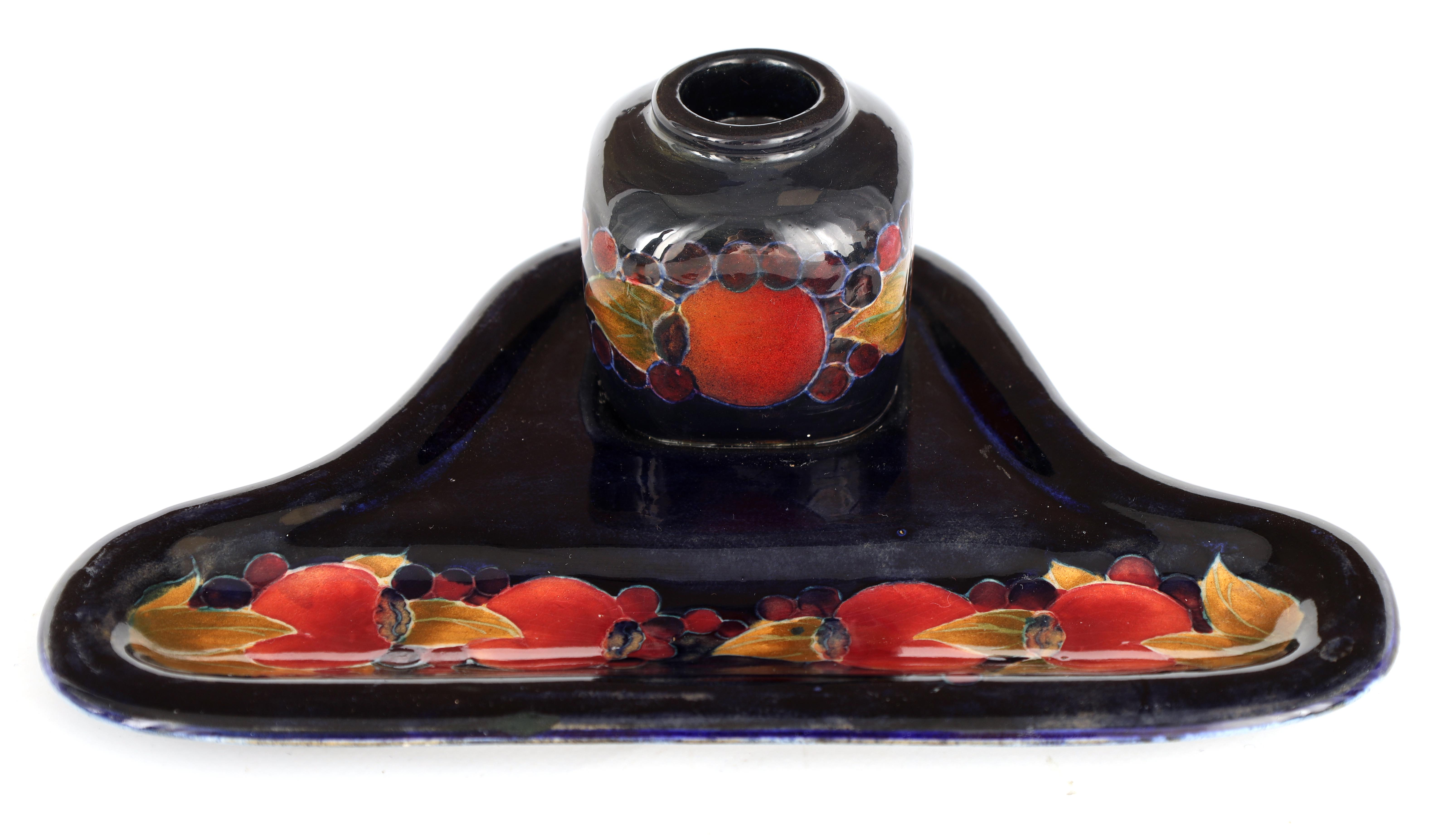 A MOORCROFT BURSLEM SHAPED COMBINED PEN TRAY AND INKSTAND with shaped base and square inkwell tube