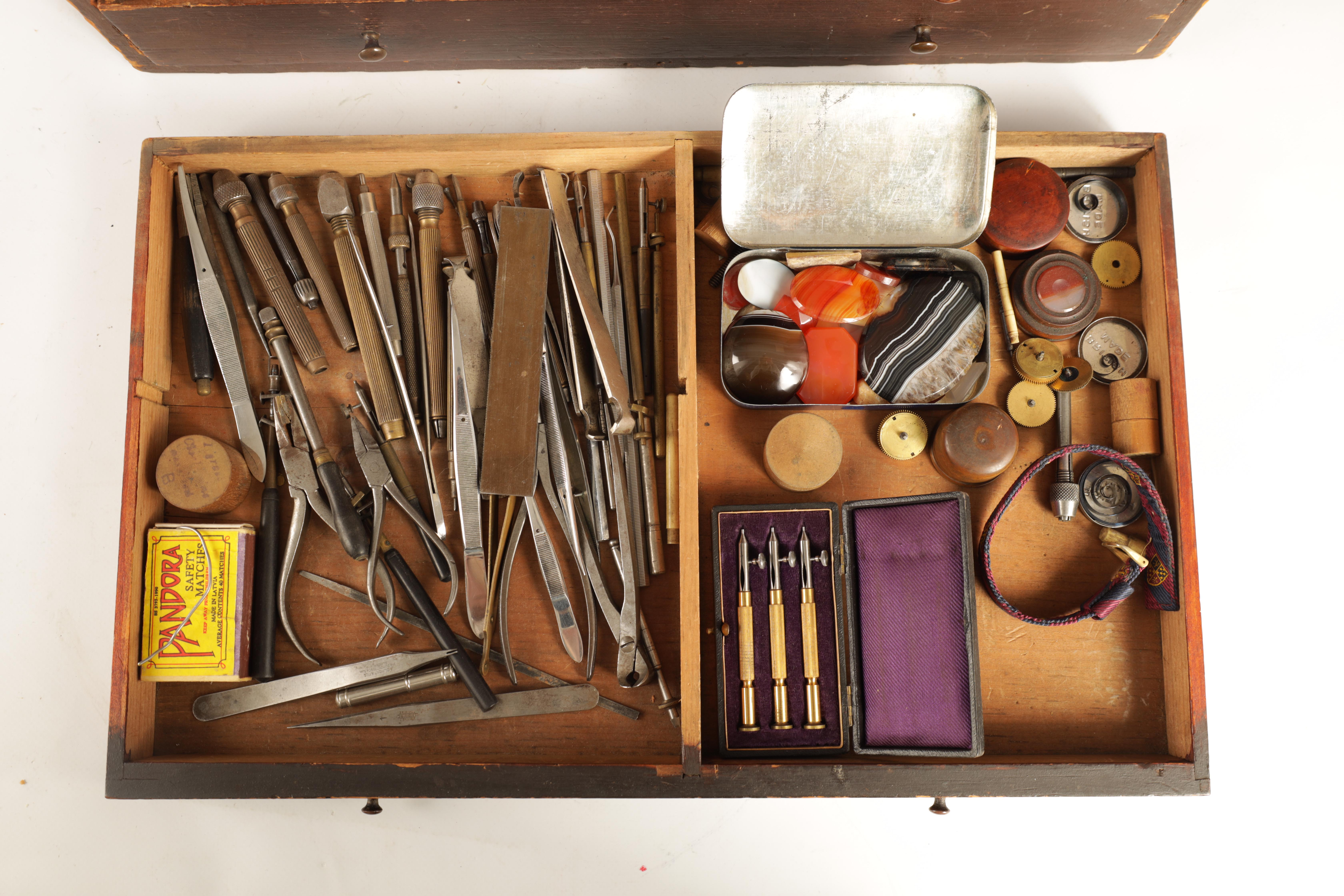 A LARGE COLLECTION OF JEWELERS AND WATCHMAKERS TOOLS contained in a set of pine drawers - Image 7 of 12