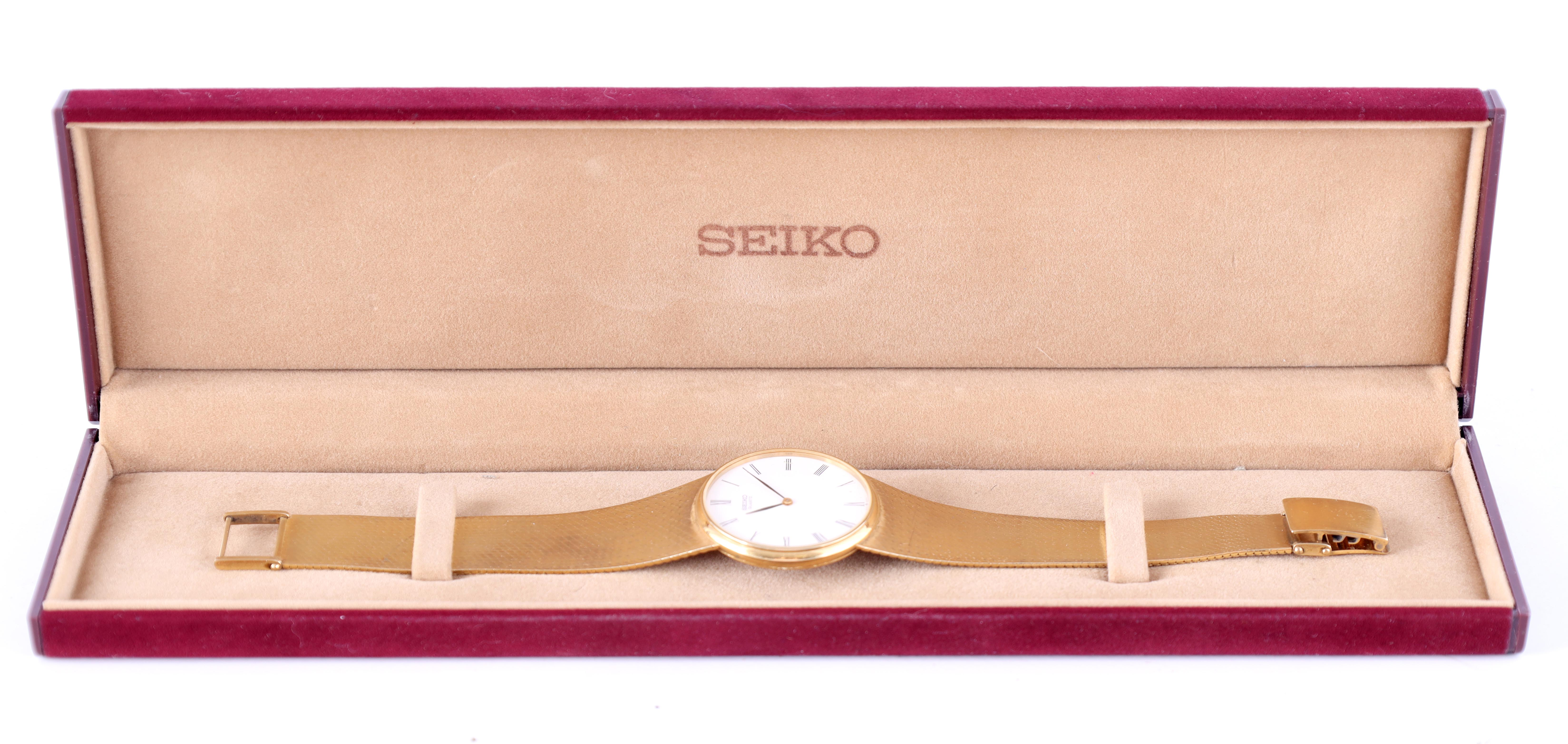 A GENTLEMAN'S 9CT GOLD SEIKO WRISTWATCH on original 9ct gold bracelet The white enamel dial with - Image 3 of 8