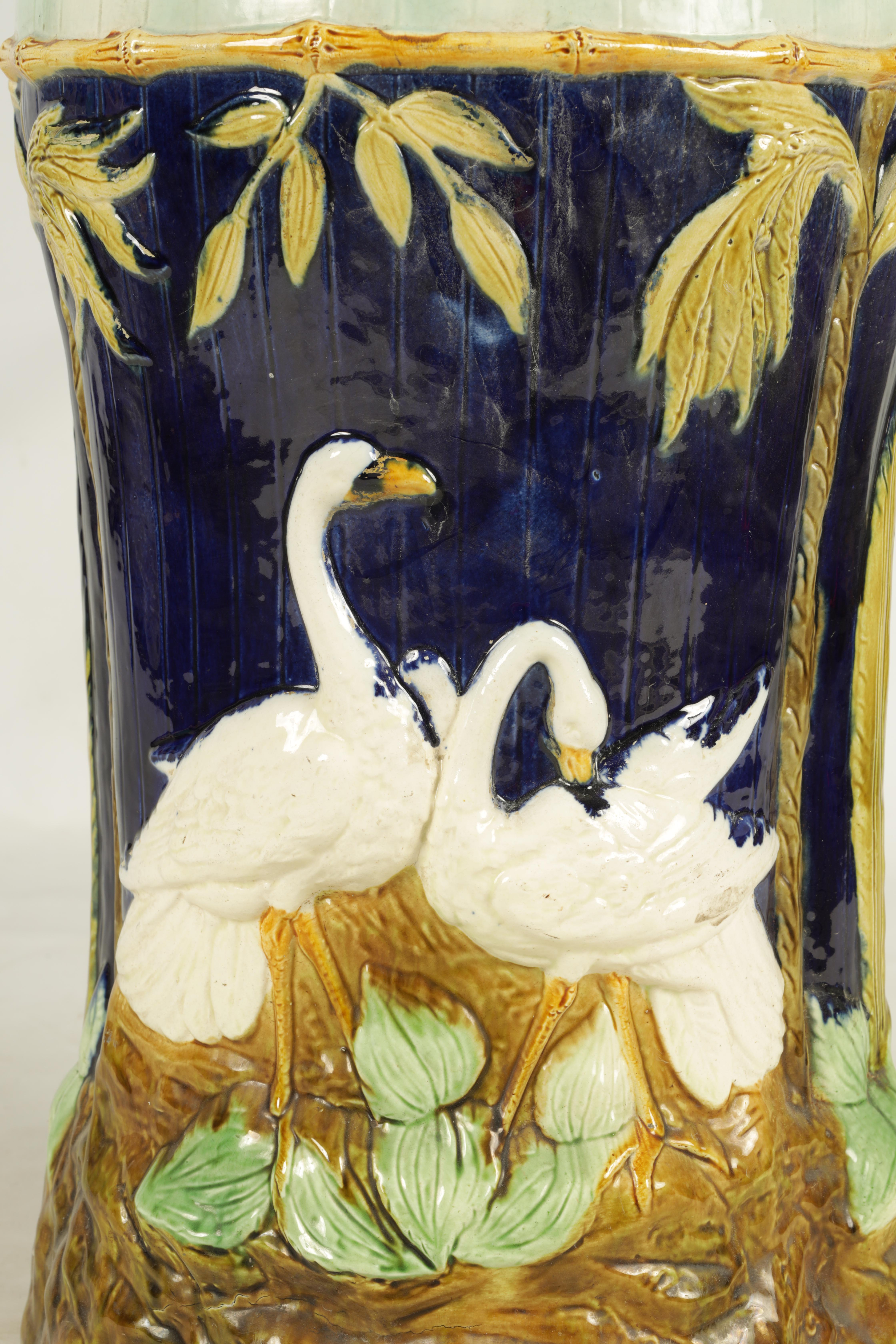 A LATE 19TH CENTURY MAJOLICA GARDEN SEAT decorated with storks between palm trees 54cm high - Image 3 of 8