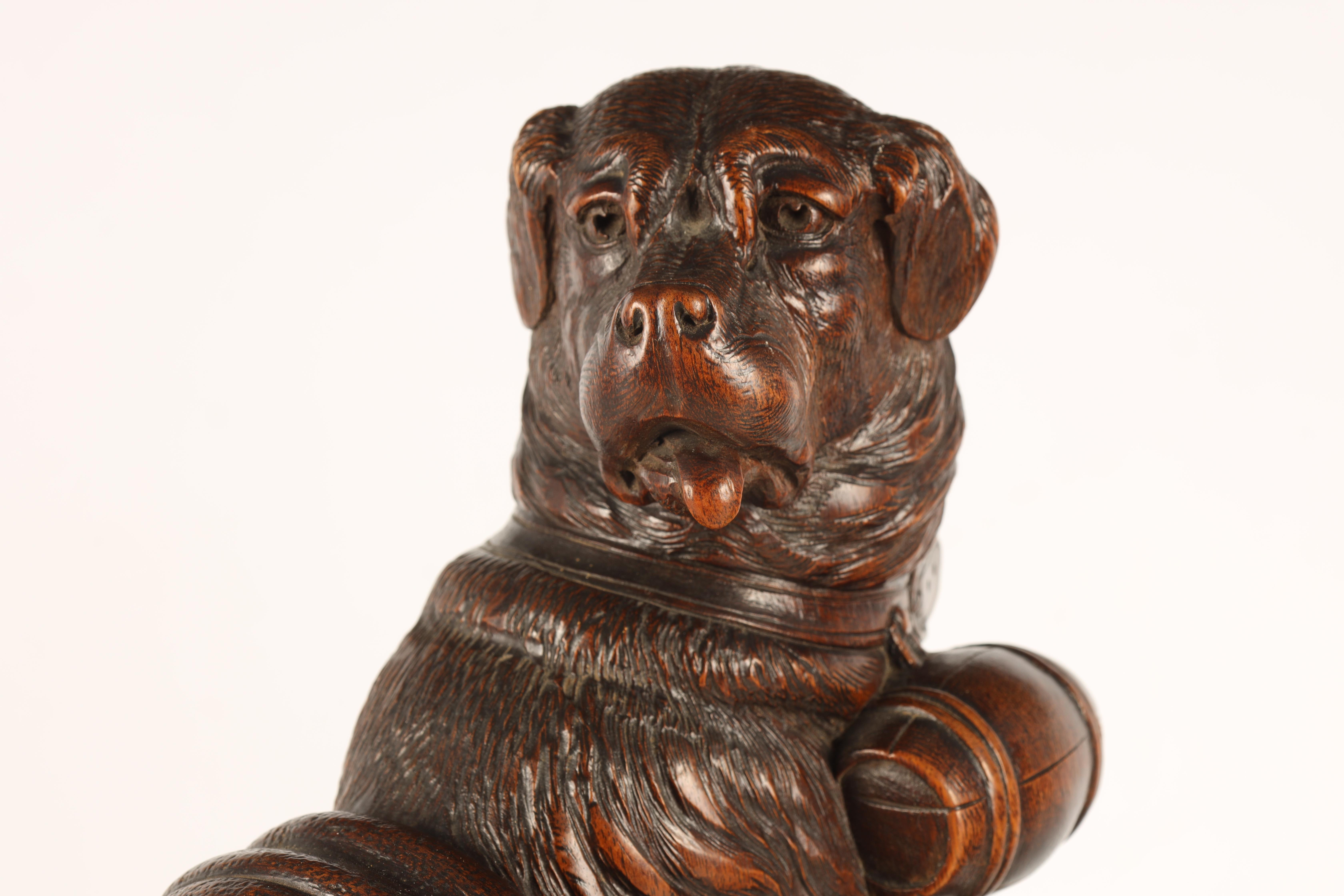 A GOOD QUALITY PAIR OF LATE 19TH CENTURY BLACK FOREST CARVED SCULPTURES modelled as Saint Bernards - Image 4 of 6