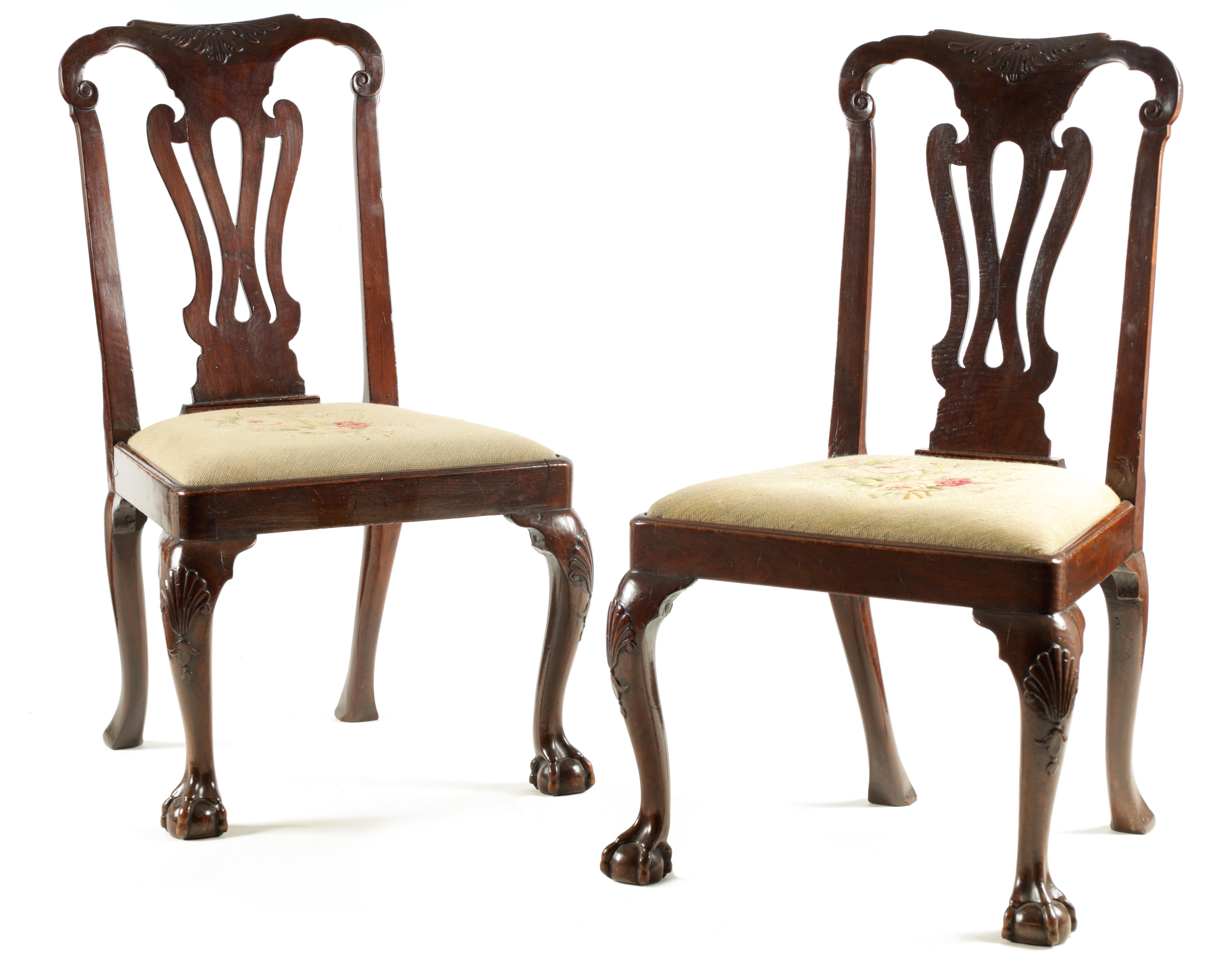 A PAIR OF GEORGE I WALNUT SIDE CHAIRS with leaf carved and scrolled top rails above vase-shaped