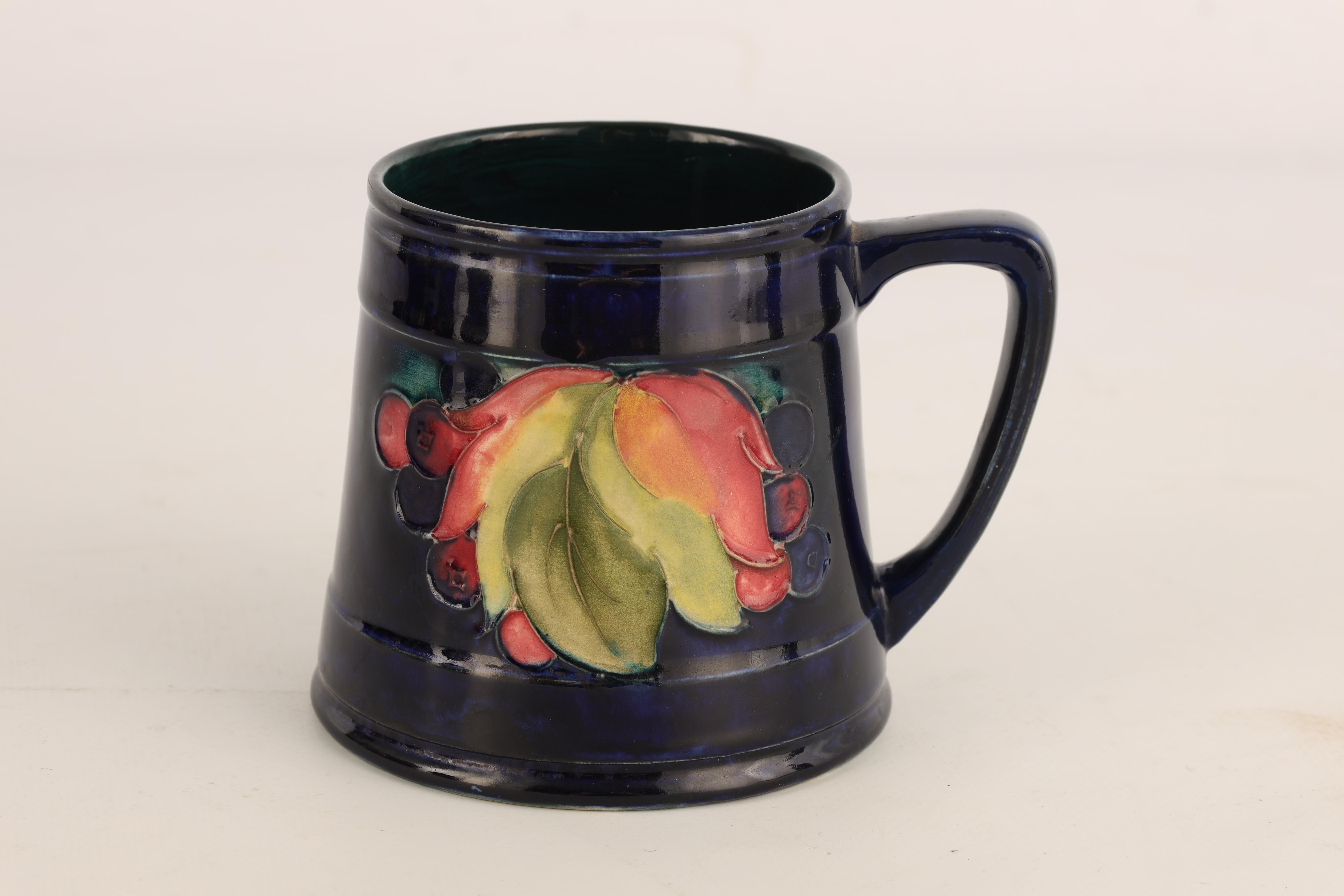 A 1930S/40S MOORCROFT TAPERING MUG tube lined and decorated with Leaf and Berry sprays, 10cm high, - Image 3 of 5
