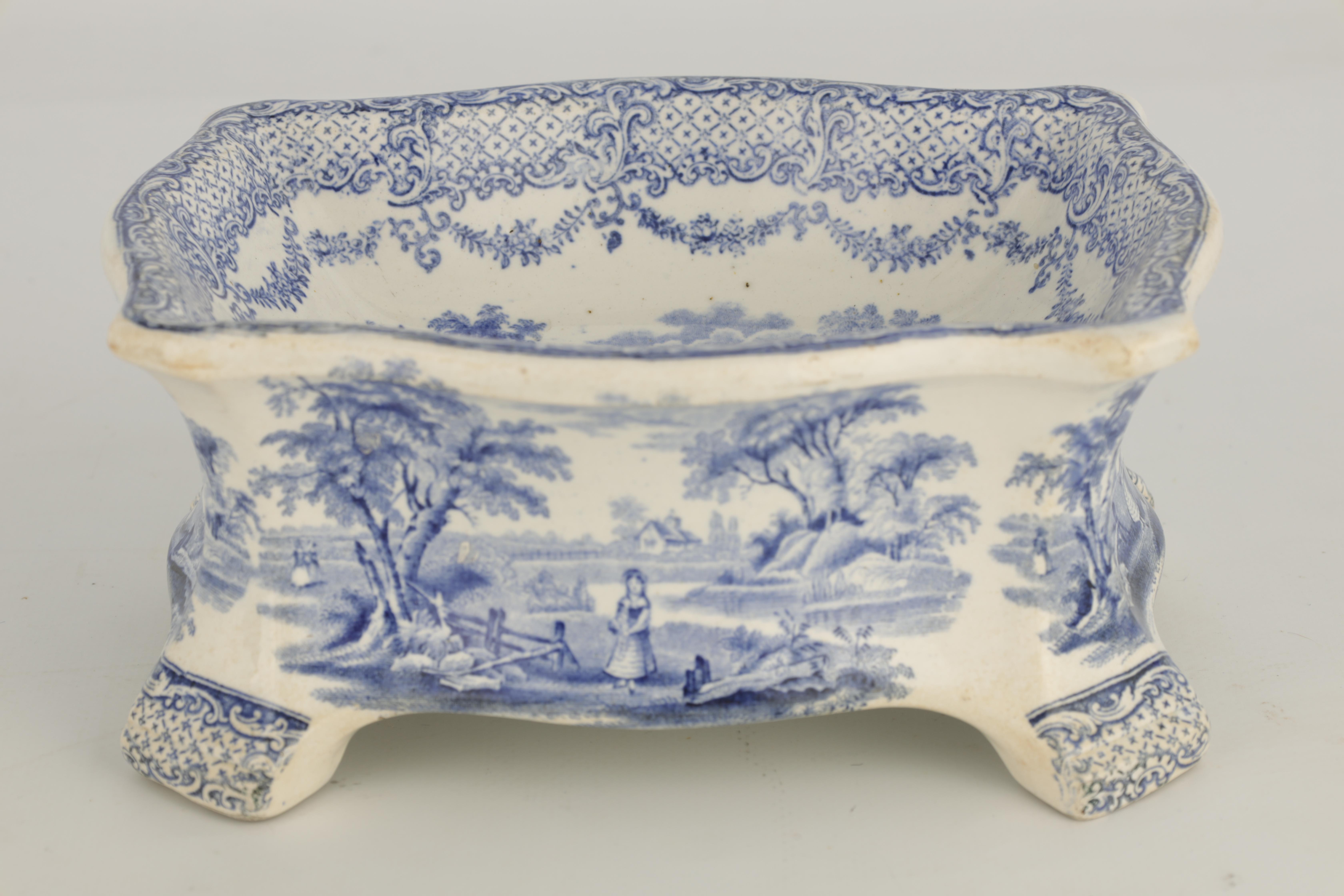 A RARE 19TH CENTURY RIDGWAY BLUE AND WHITE POTTERY DOG BOWL decorated with landscape scenes - Image 3 of 7