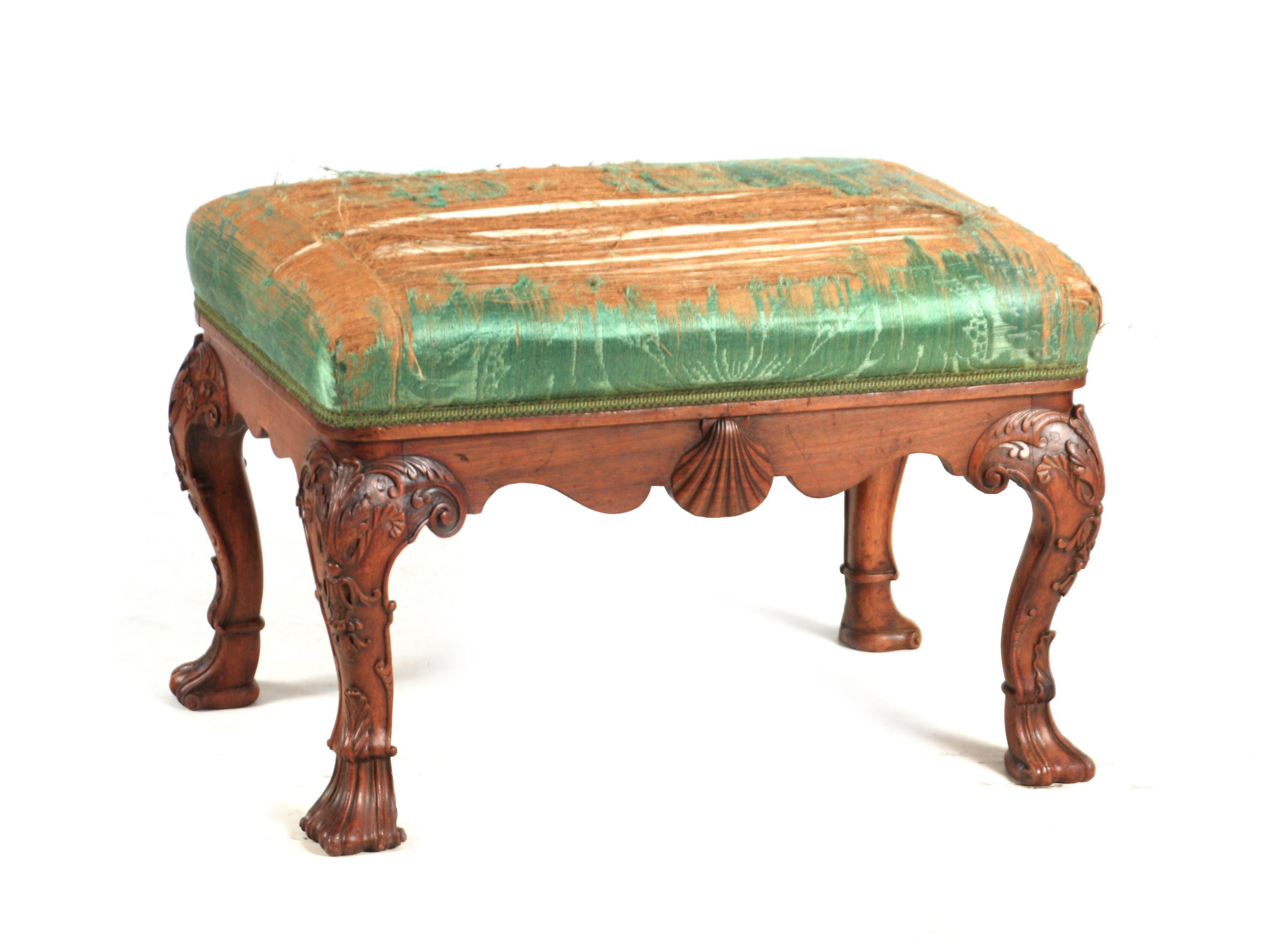 A MID 18TH CENTURY IRISH STYLE MAHOGANY DRESSING TABLE STOOL with upholstered top above shaped rails
