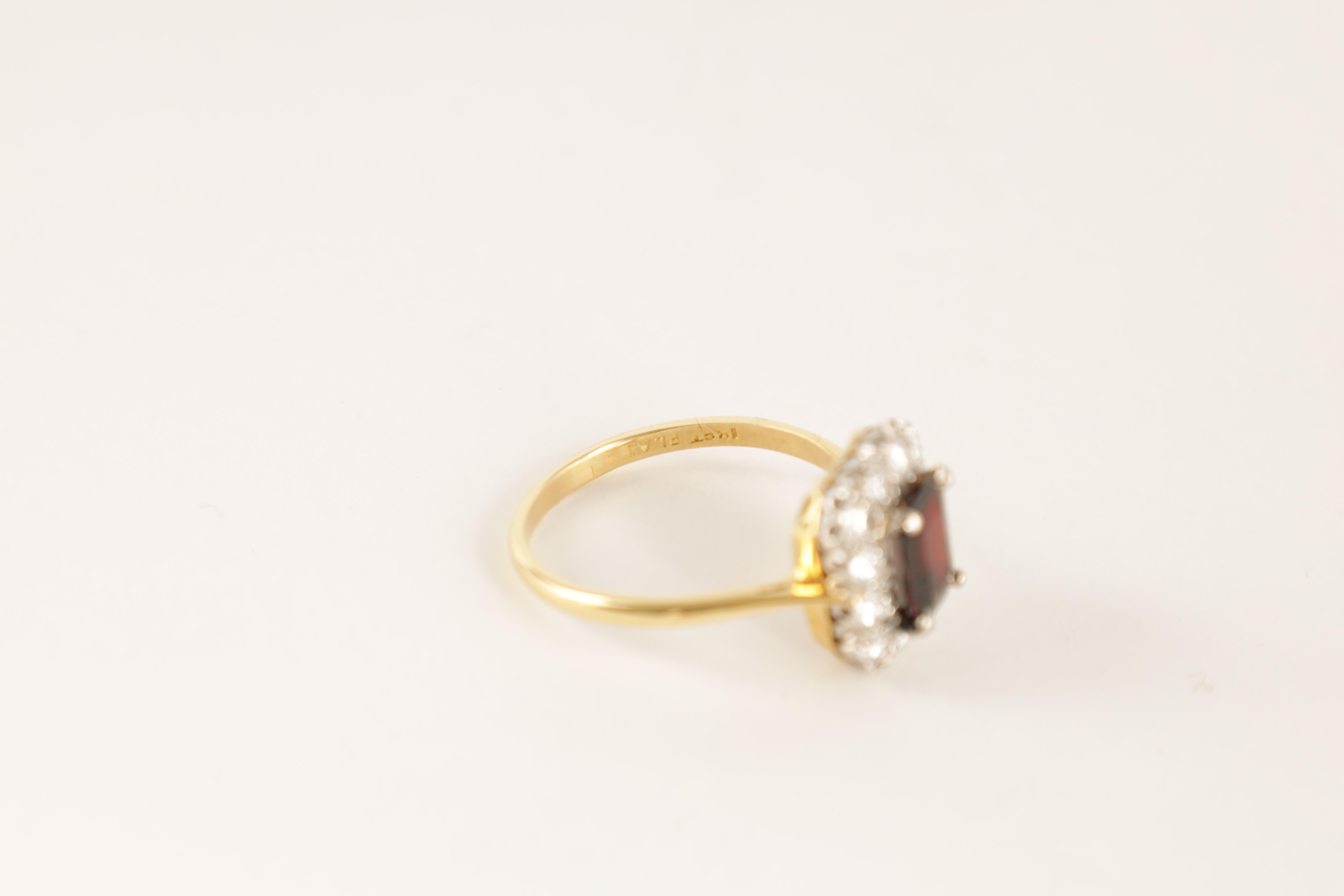 A LADIES 18CT GOLD AND PLATINUM RUBY AND DIAMOND RING with emerald cut ruby surrounded by 12 - Image 3 of 4
