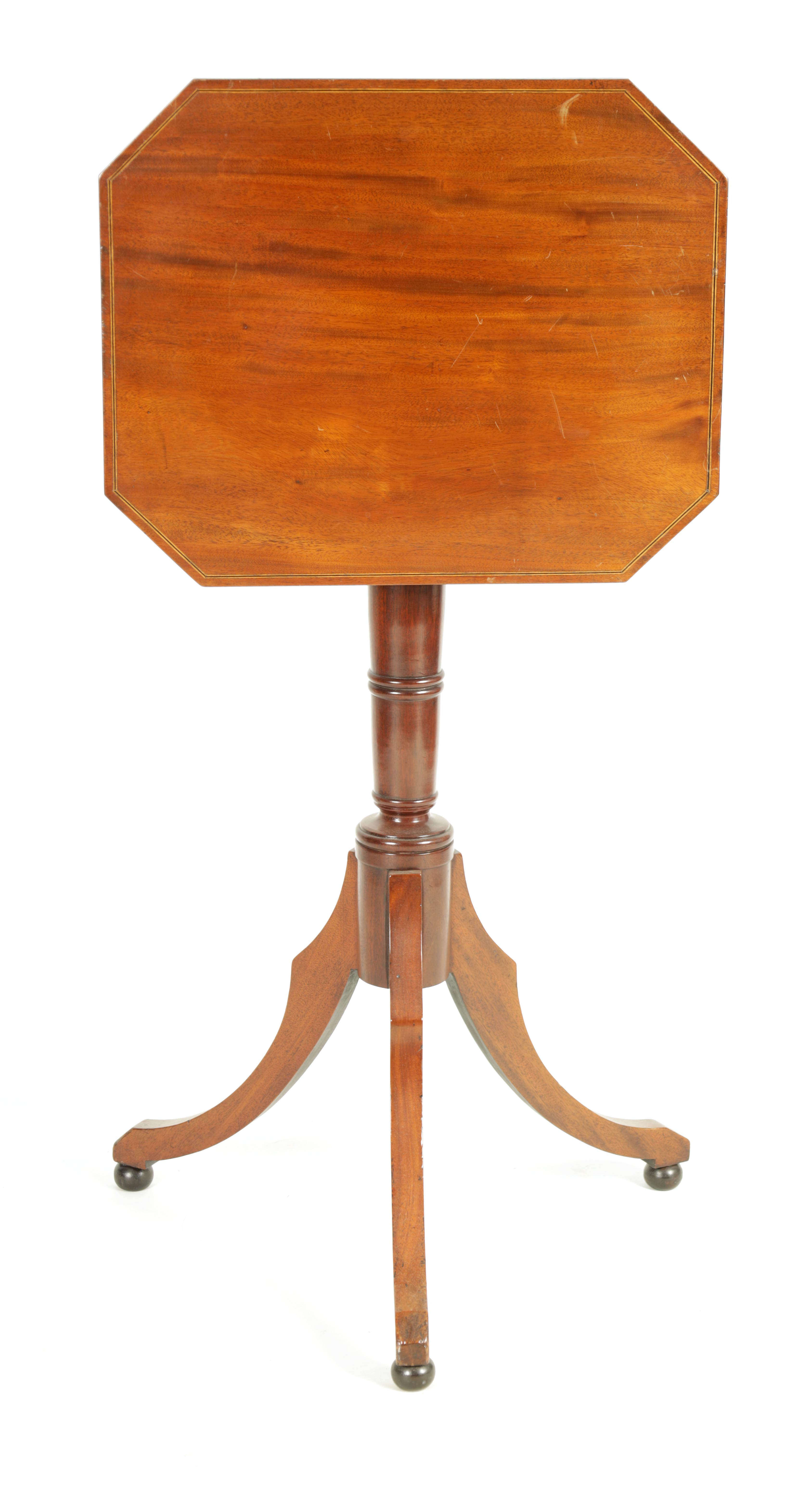 A REGENCY MAHOGANY ADJUSTABLE OCCASIONAL/READING TABLE with clipped corners and tilting top,