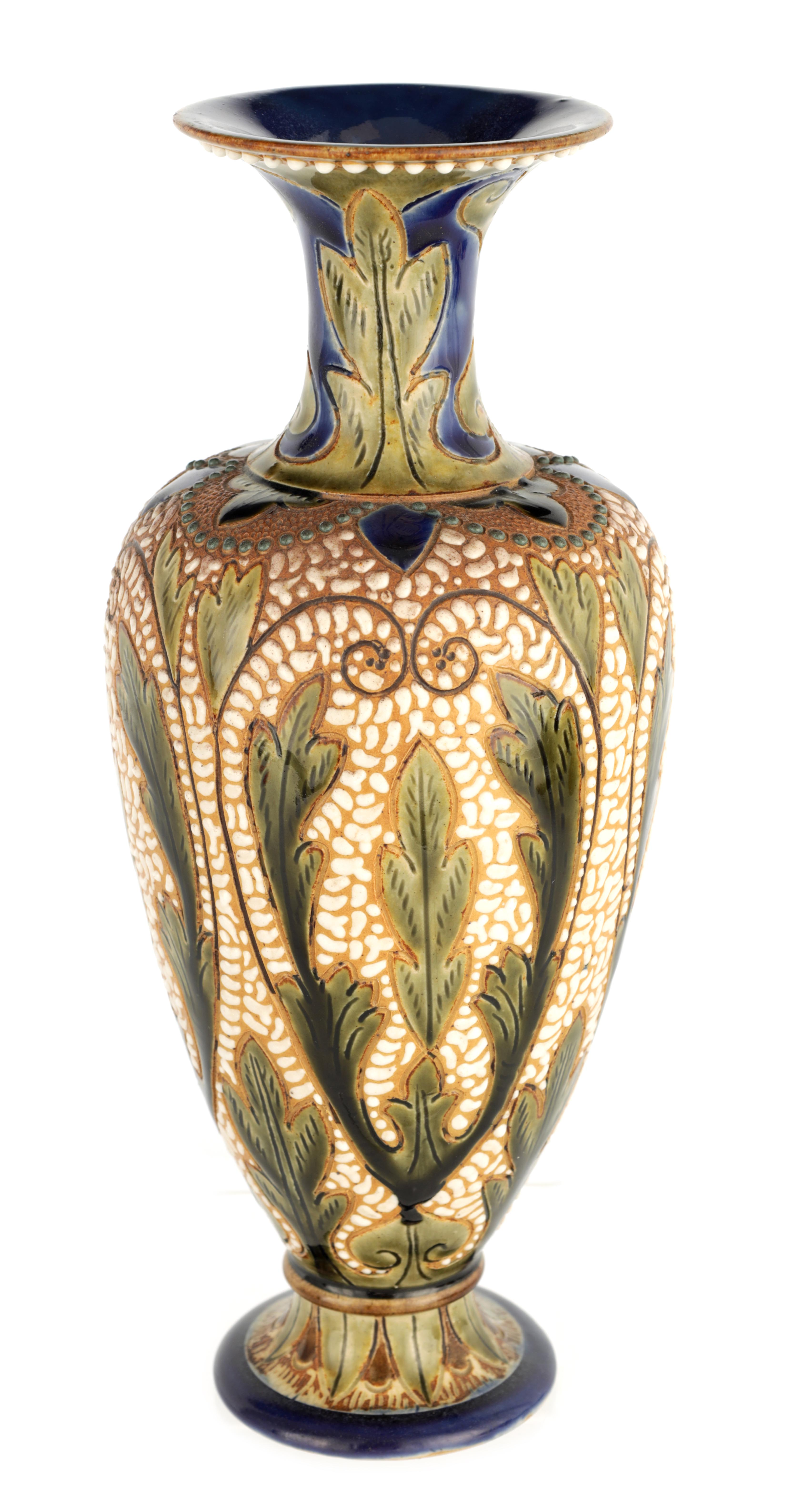 AN UNUSUAL LATE 19TH CENTURY FULHAM POTTERY STONEWARE FOOTED OVOID VASE WITH FLARED RIM decorated