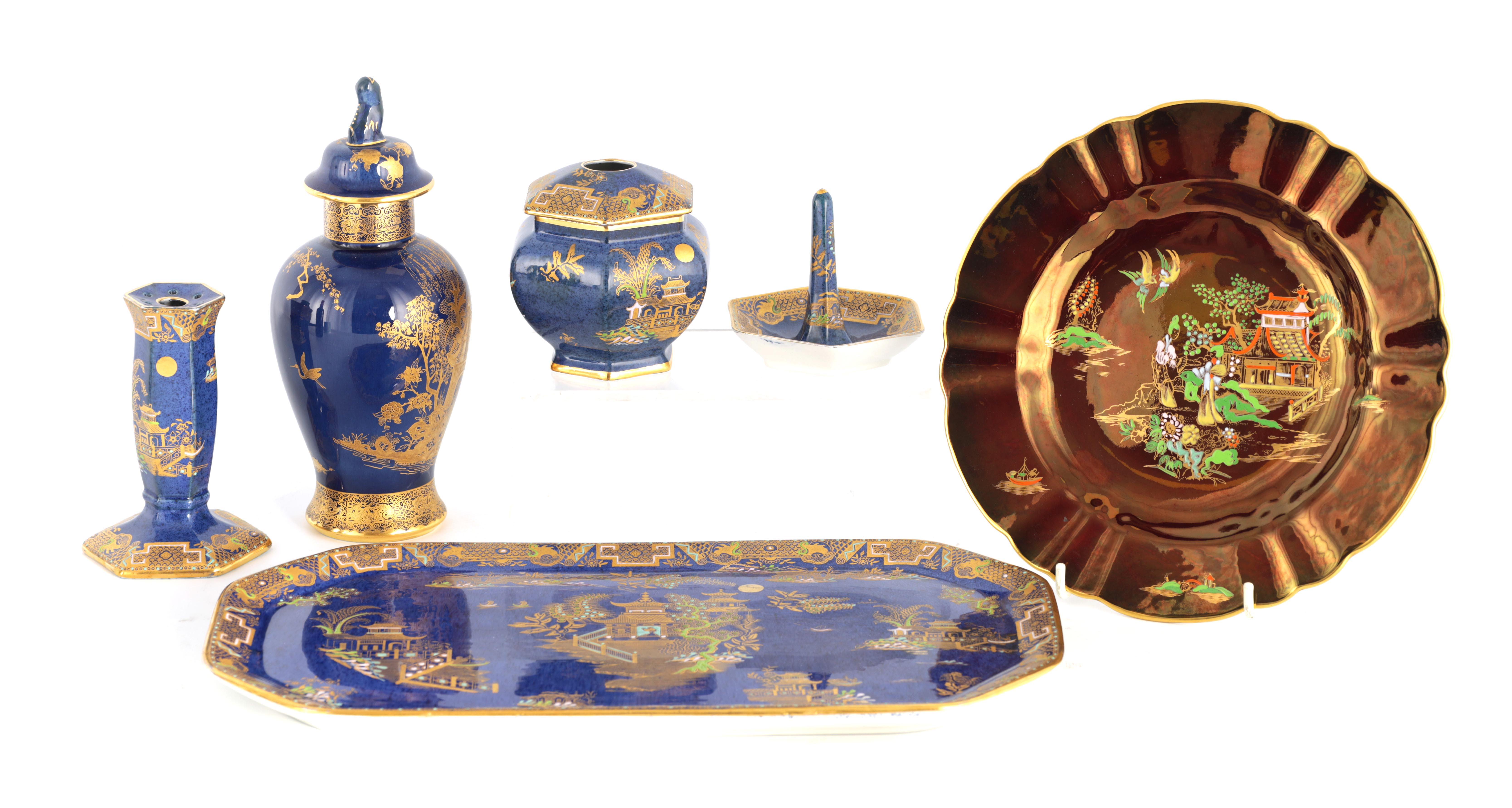 A CARLTON WARE FIVE PIECE DRESSING TABLE SET decorated in an oriental gilt pattern with pagodas