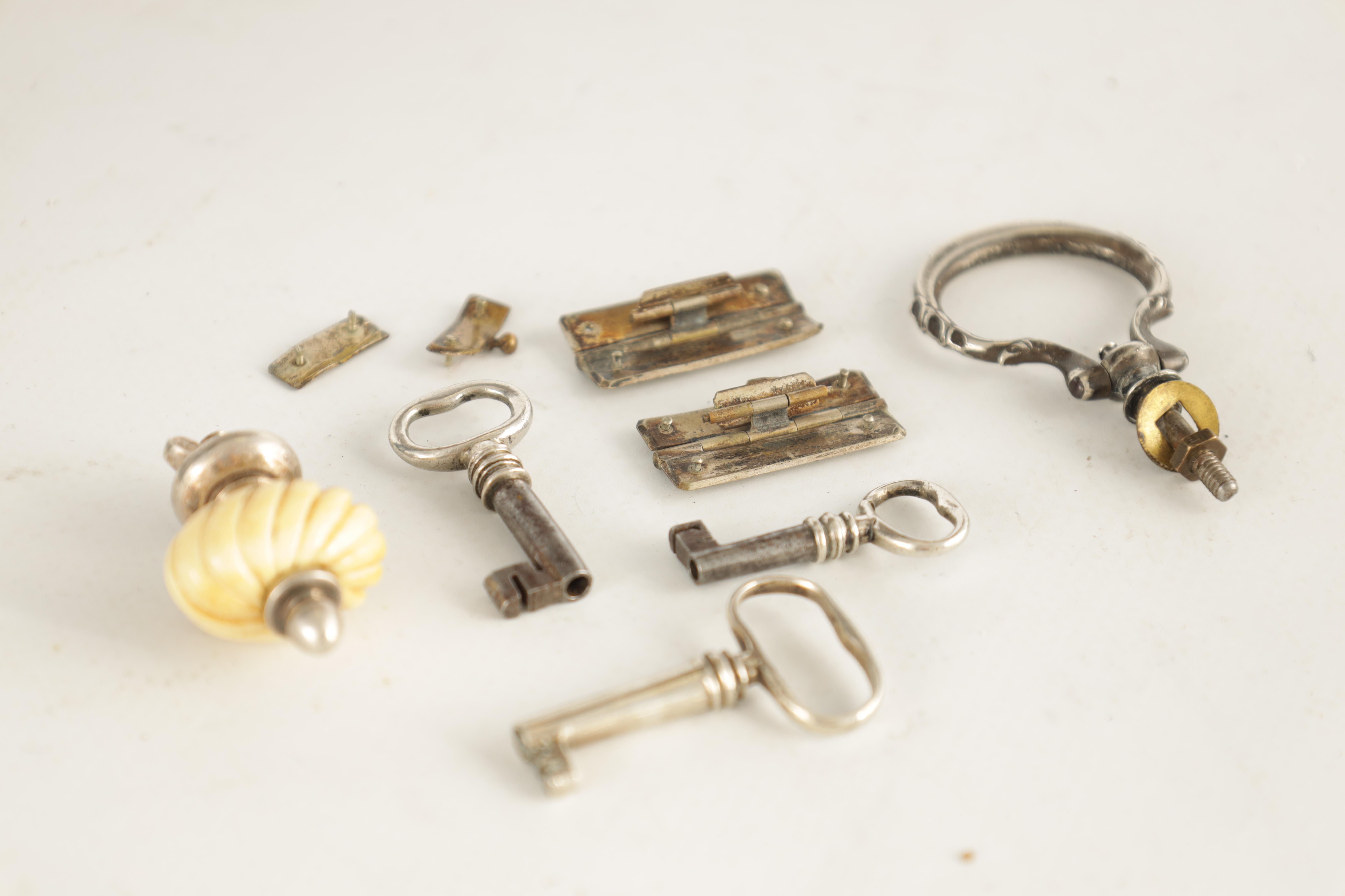 A SELECTION OF SILVER KEYS, FINIALS AND HINGES 7 items in total - Image 2 of 2