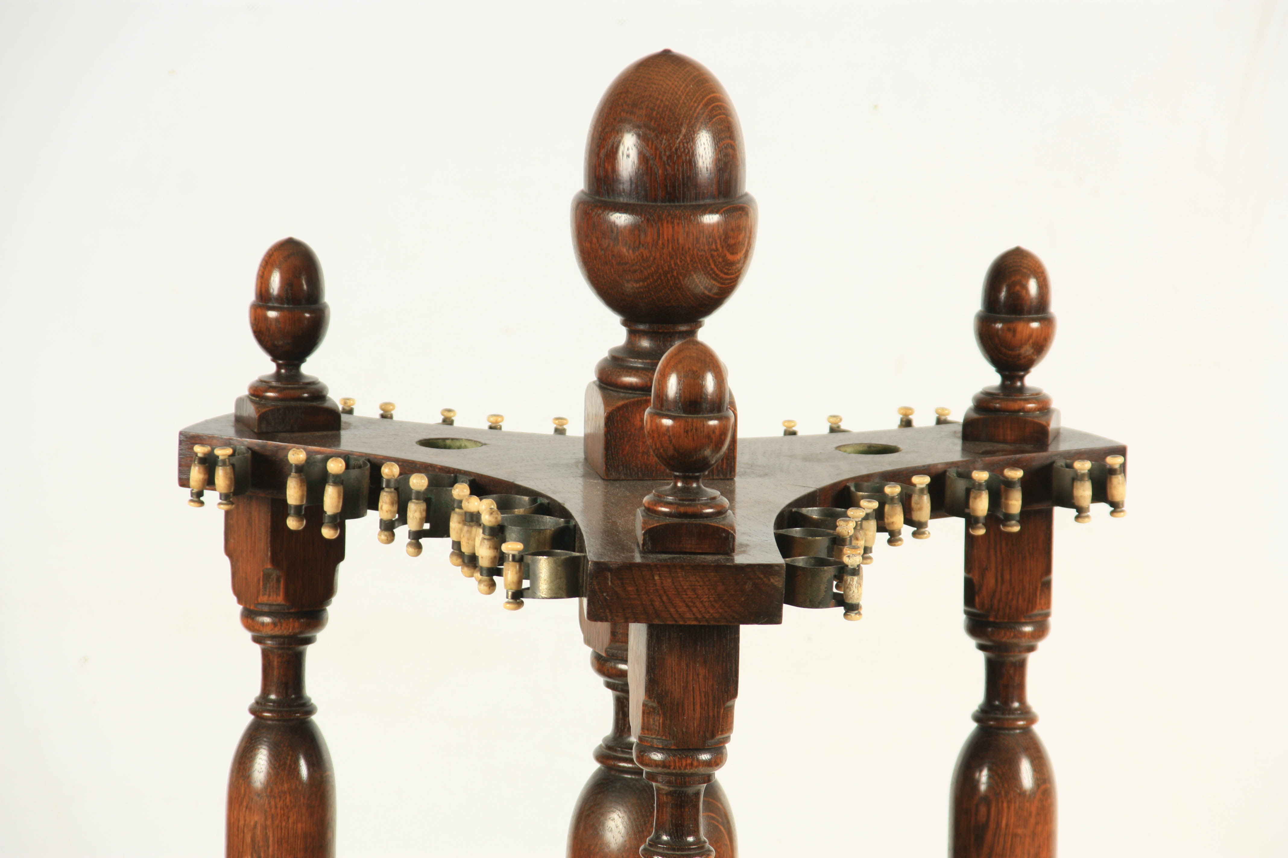 A LATE 19TH/ EARLY 20TH CENTURY REVOLVING OAK SNOOKER CUE STAND the circular base sitting on 3 bun - Image 3 of 5