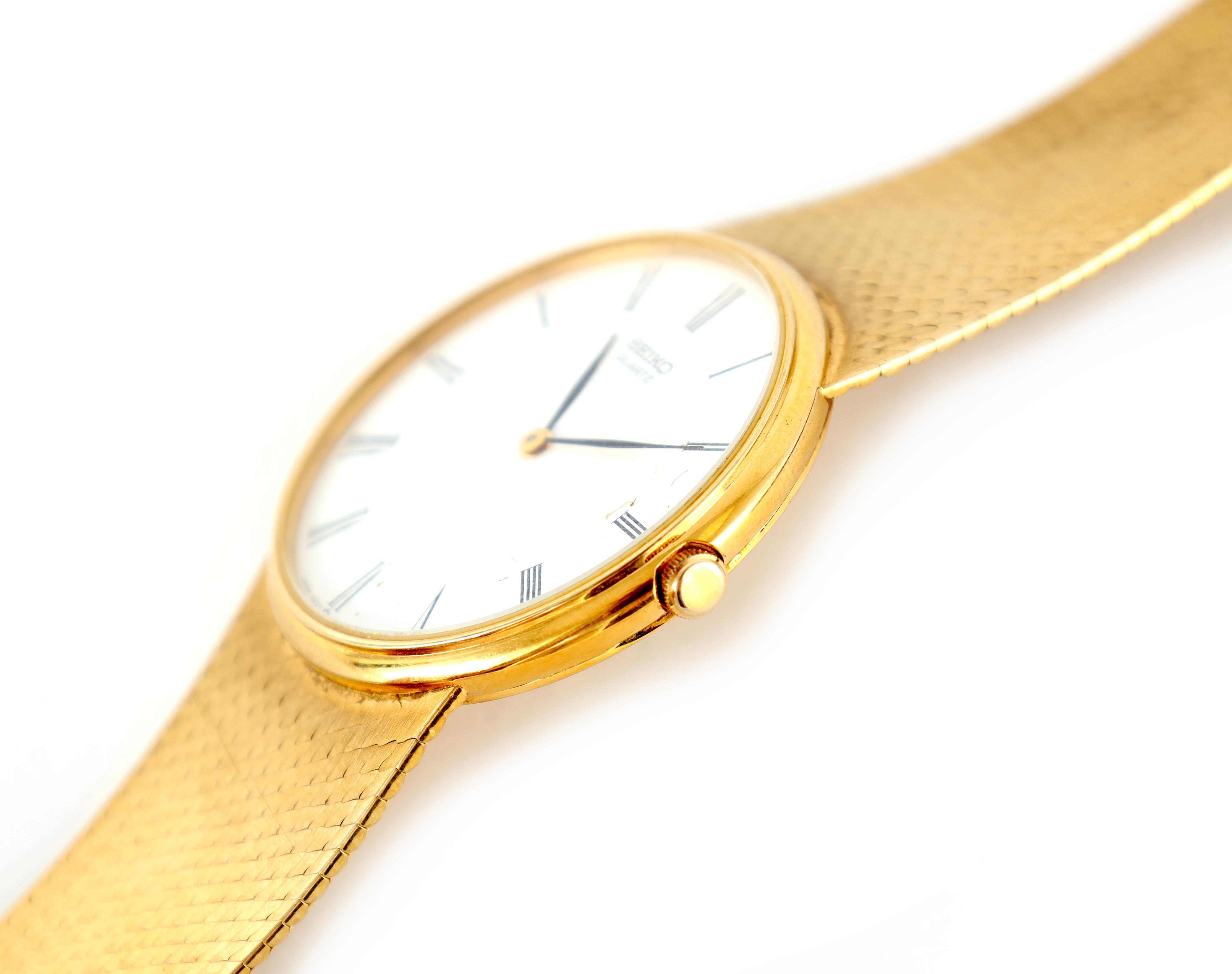 A GENTLEMAN'S 9CT GOLD SEIKO WRISTWATCH on original 9ct gold bracelet The white enamel dial with - Image 7 of 8