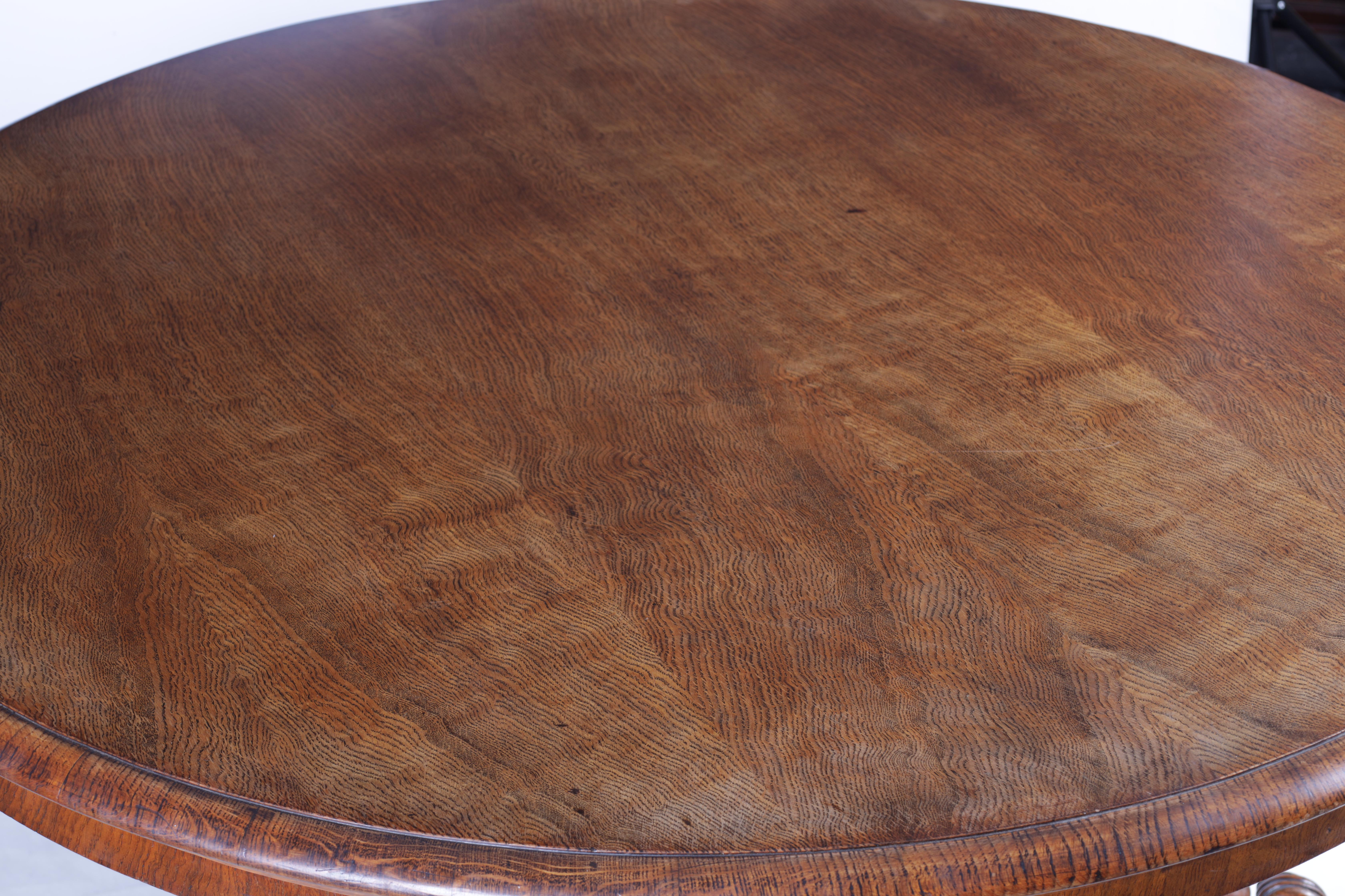 A 19TH CENTURY POLLARD OAK CENTRE TABLE with circular moulded edge above a hexagonal base with - Image 5 of 7
