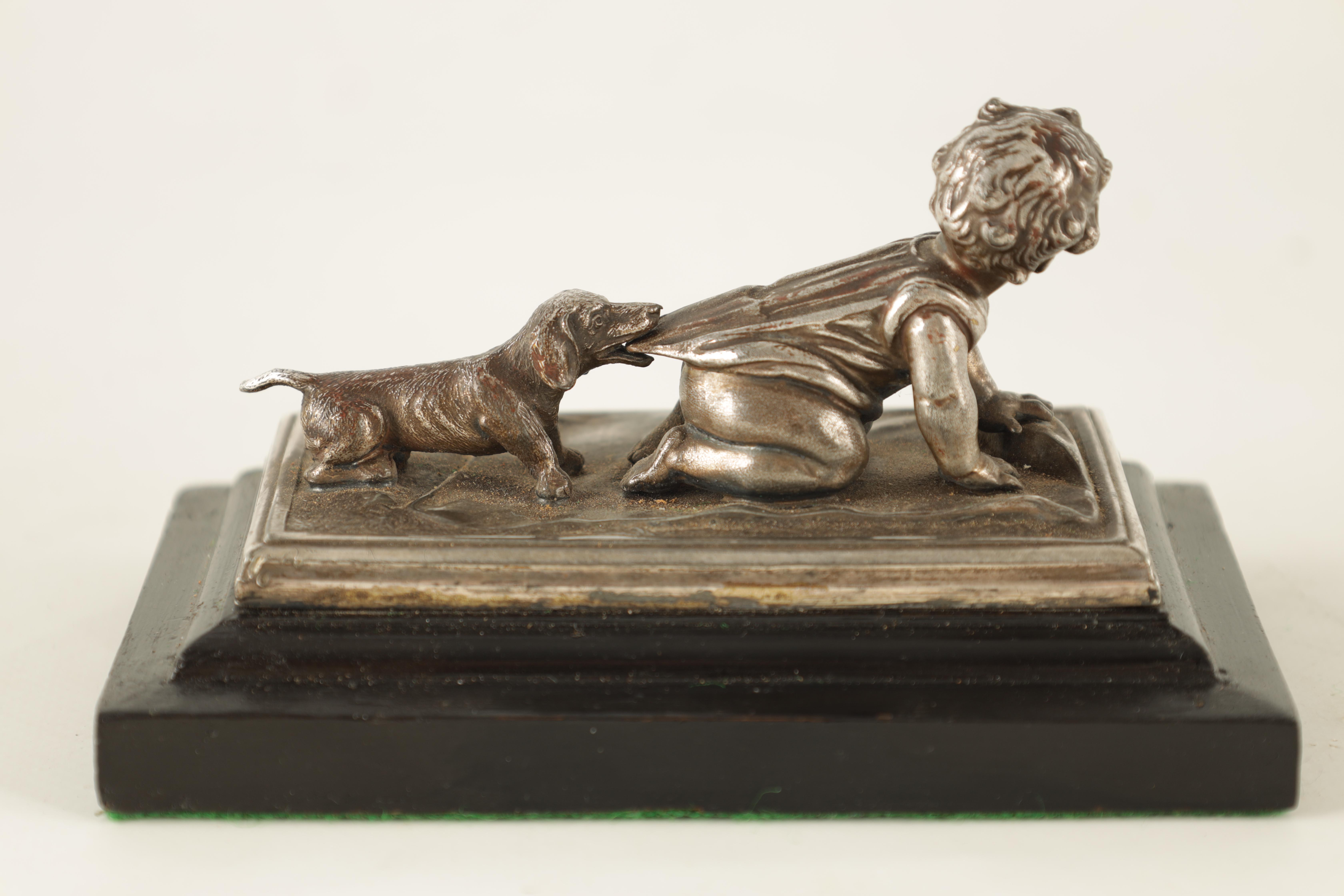 AN UNUSUAL 19TH CENTURY W.M.F. SILVERED METAL DESK PAPERWEIGHT depicting a small child with a - Image 4 of 5