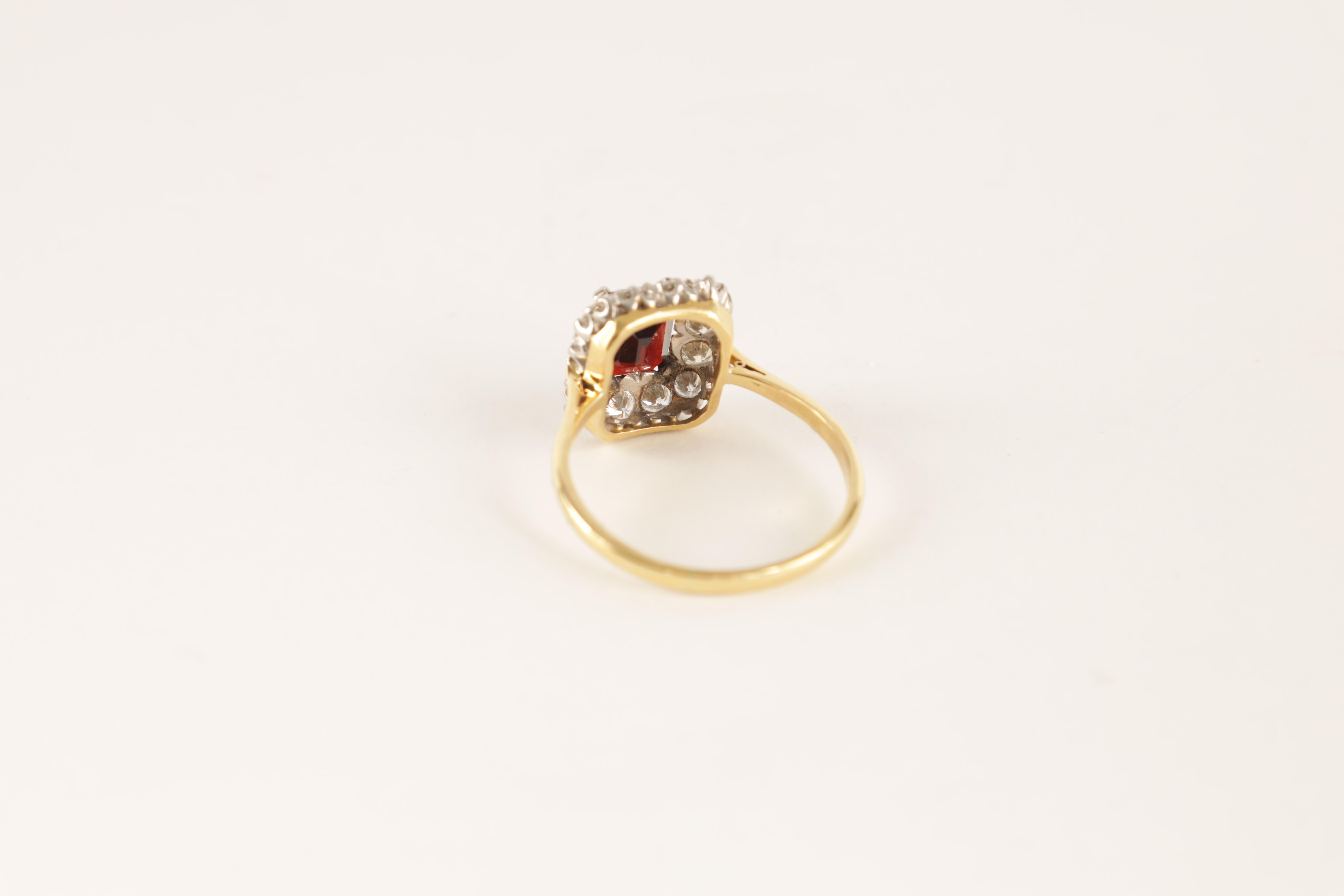 A LADIES 18CT GOLD AND PLATINUM RUBY AND DIAMOND RING with emerald cut ruby surrounded by 12 - Image 4 of 4
