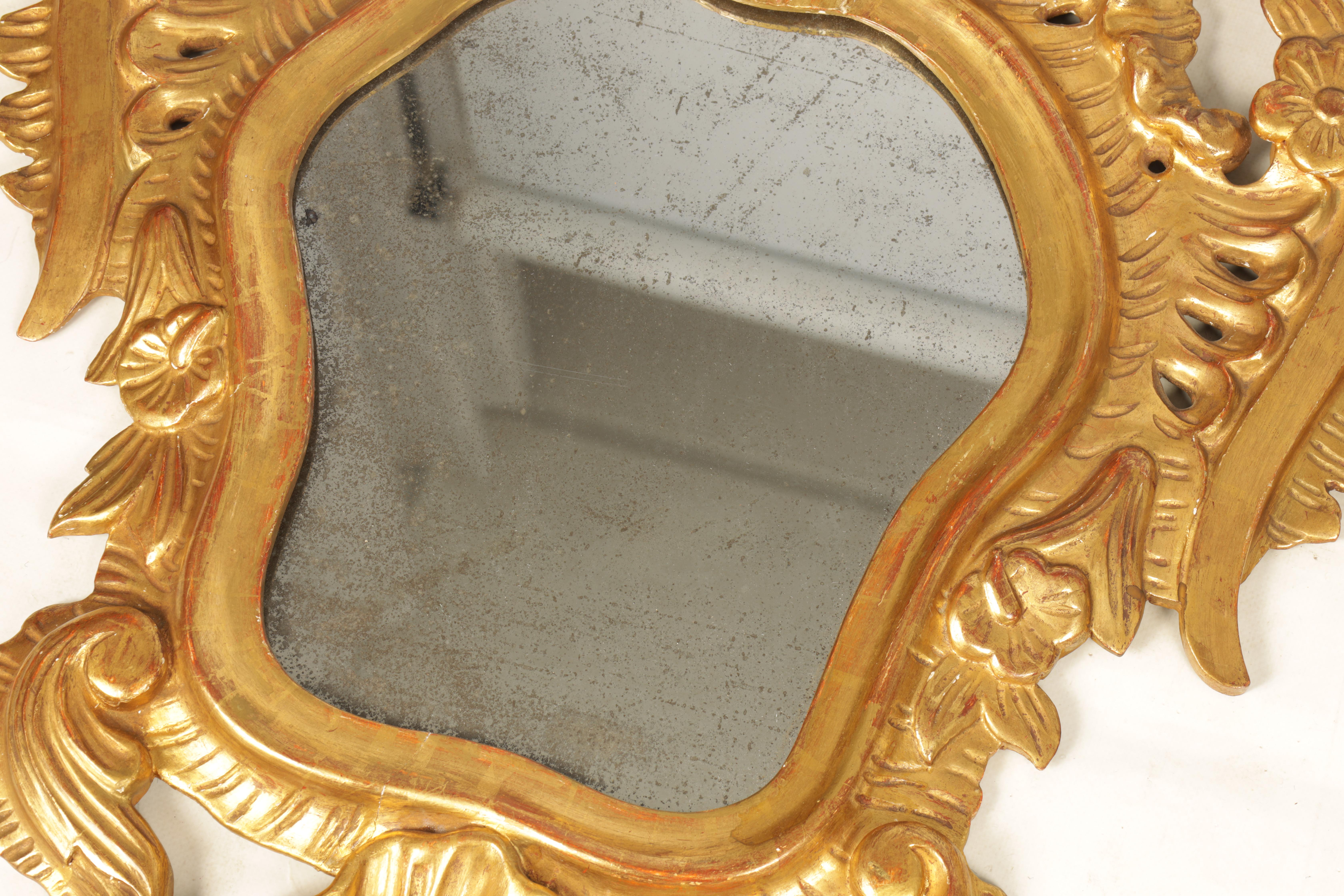 A PAIR OF 19TH CENTURY CARVED GILT WOOD ITALIAN FLORENTINE MIRRORS with leaf and shell carved frames - Image 4 of 8