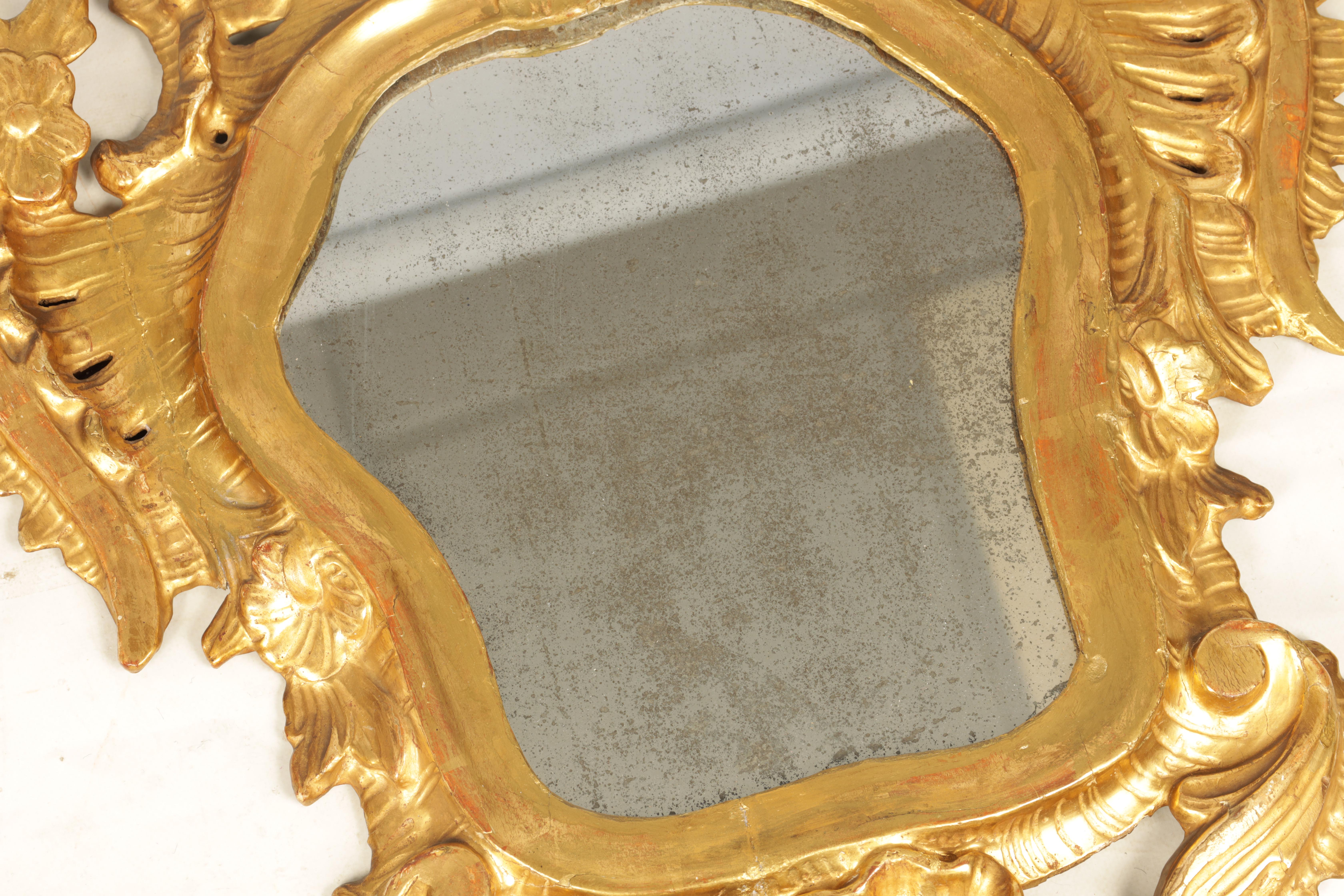 A PAIR OF 19TH CENTURY CARVED GILT WOOD ITALIAN FLORENTINE MIRRORS with leaf and shell carved frames - Image 5 of 8