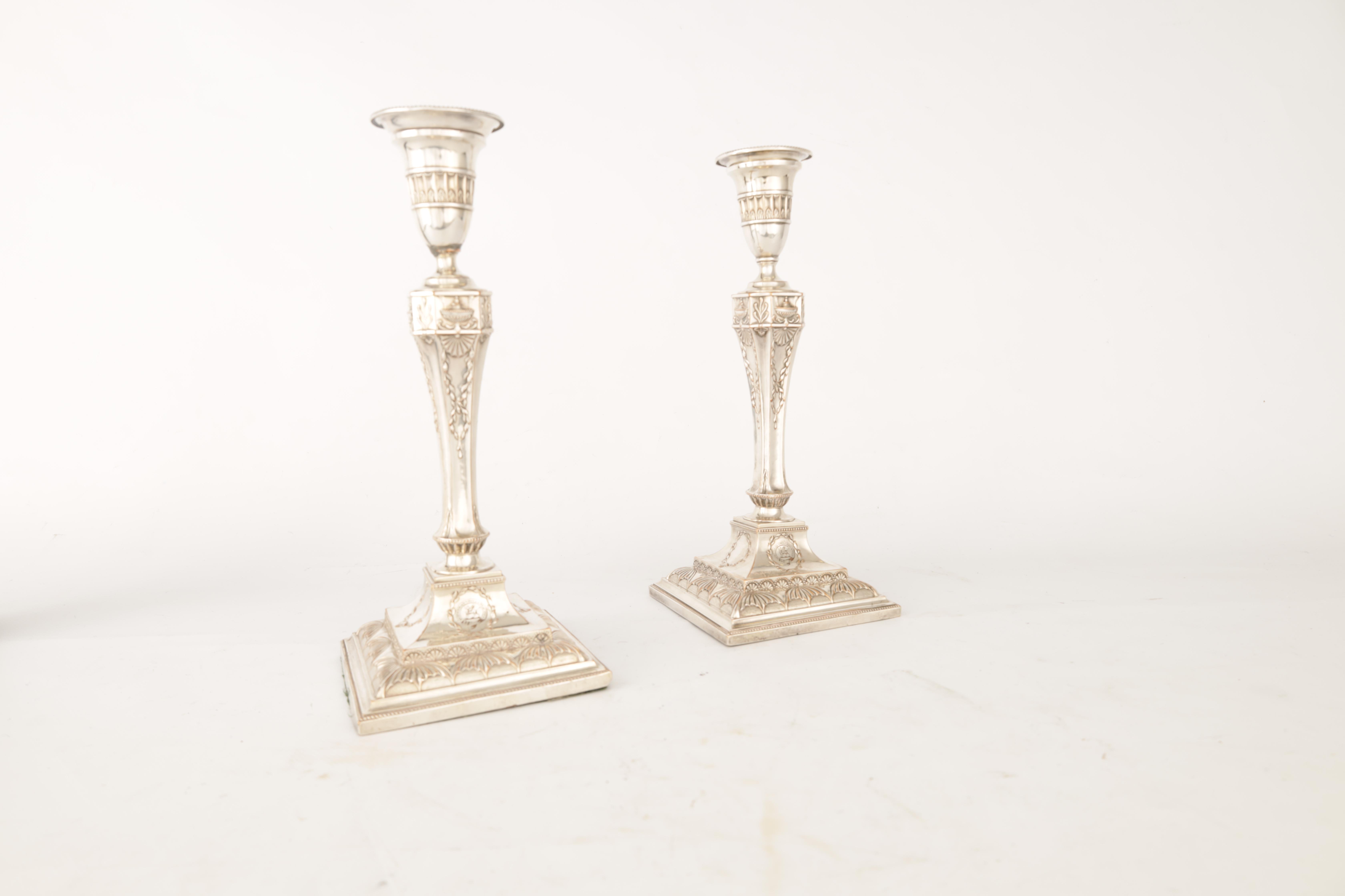 A PAIR OF 19TH CENTURY SHEFFIELD PLATE SILVER ON COPPER ADAM STYLE CANDLESTICKS bearing the crest - Image 3 of 5